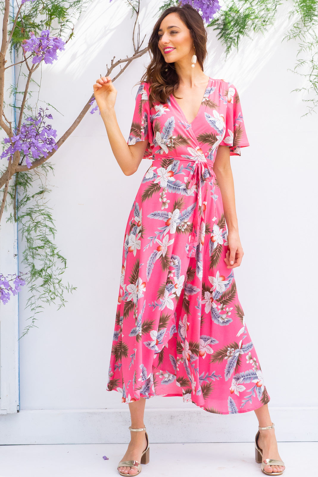 Penny Watermelon Pink Aloha Maxi Wrap dress with flutter sleeves in a candy pink tropical inspired floral print on 100% rayon