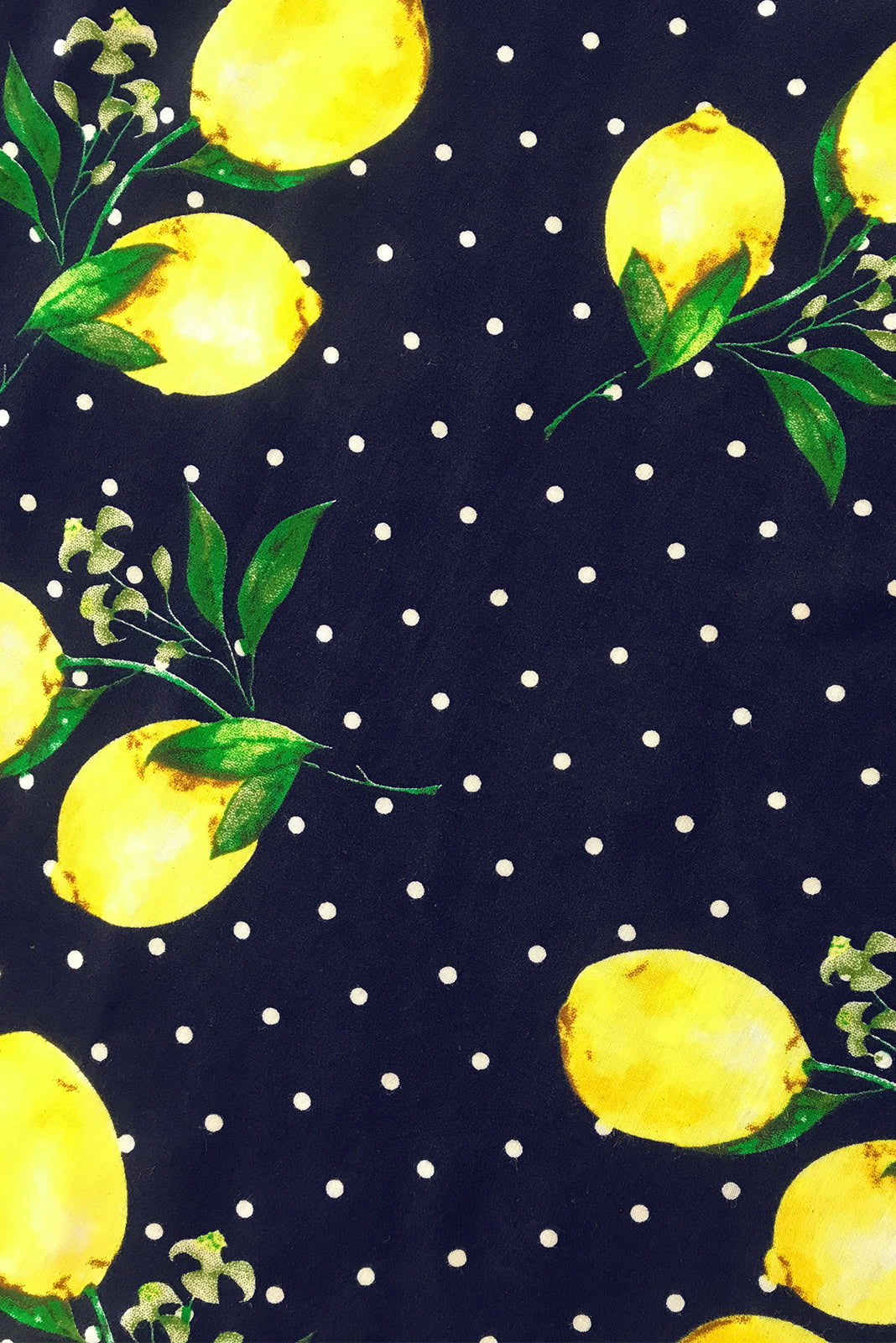 Fabric Swatch of  Petal Limoncello Ink Maxi Wrap Dress featuring  100% rayon in ink base with bold lemon print.