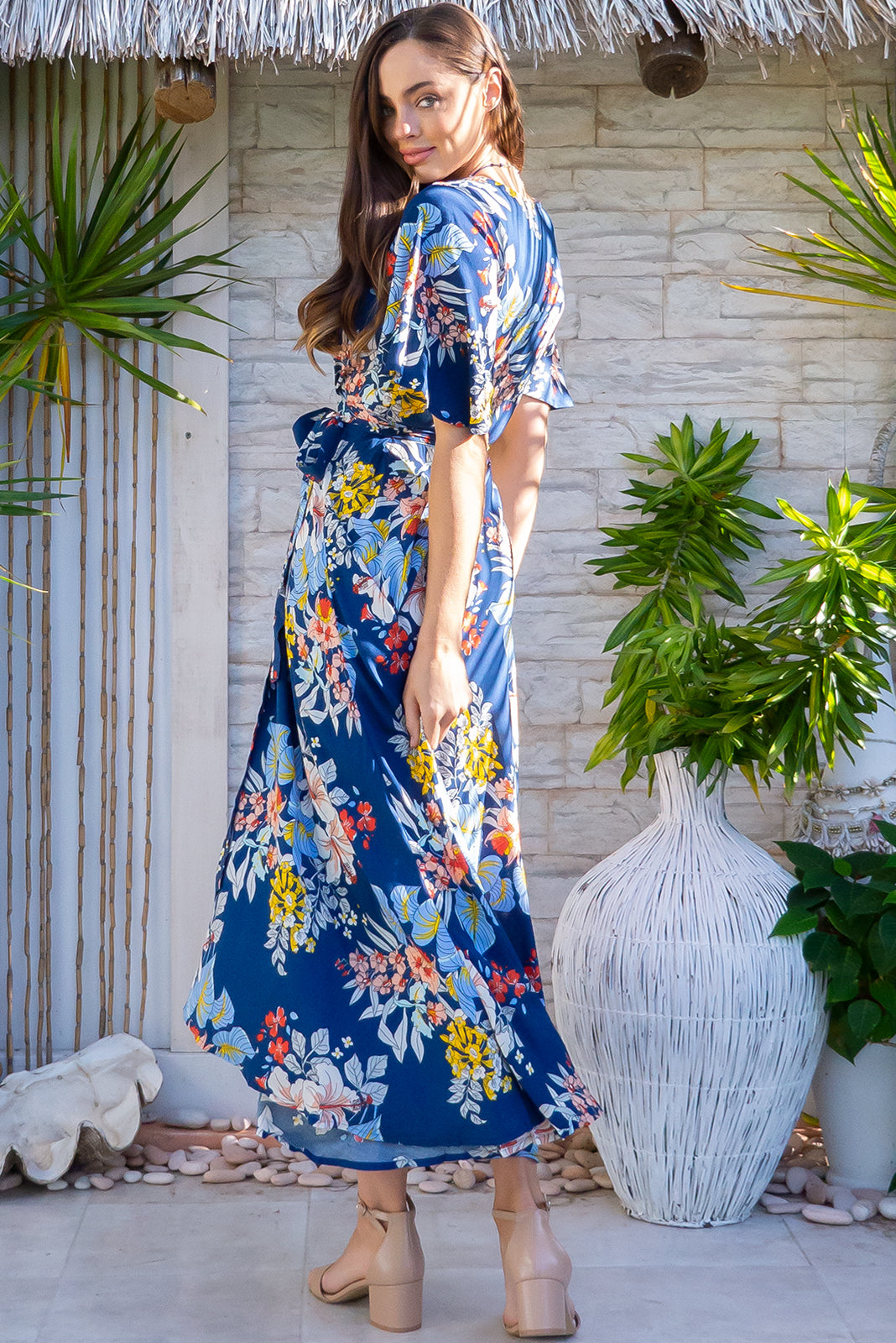 The Petal Naviti Blue Maxi Wrap Dress is a beautiful tropical print dress featuring Floaty petal sleeves, blue base with white, yellow, coral, peach and baby blue floral print in woven 100% rayon.