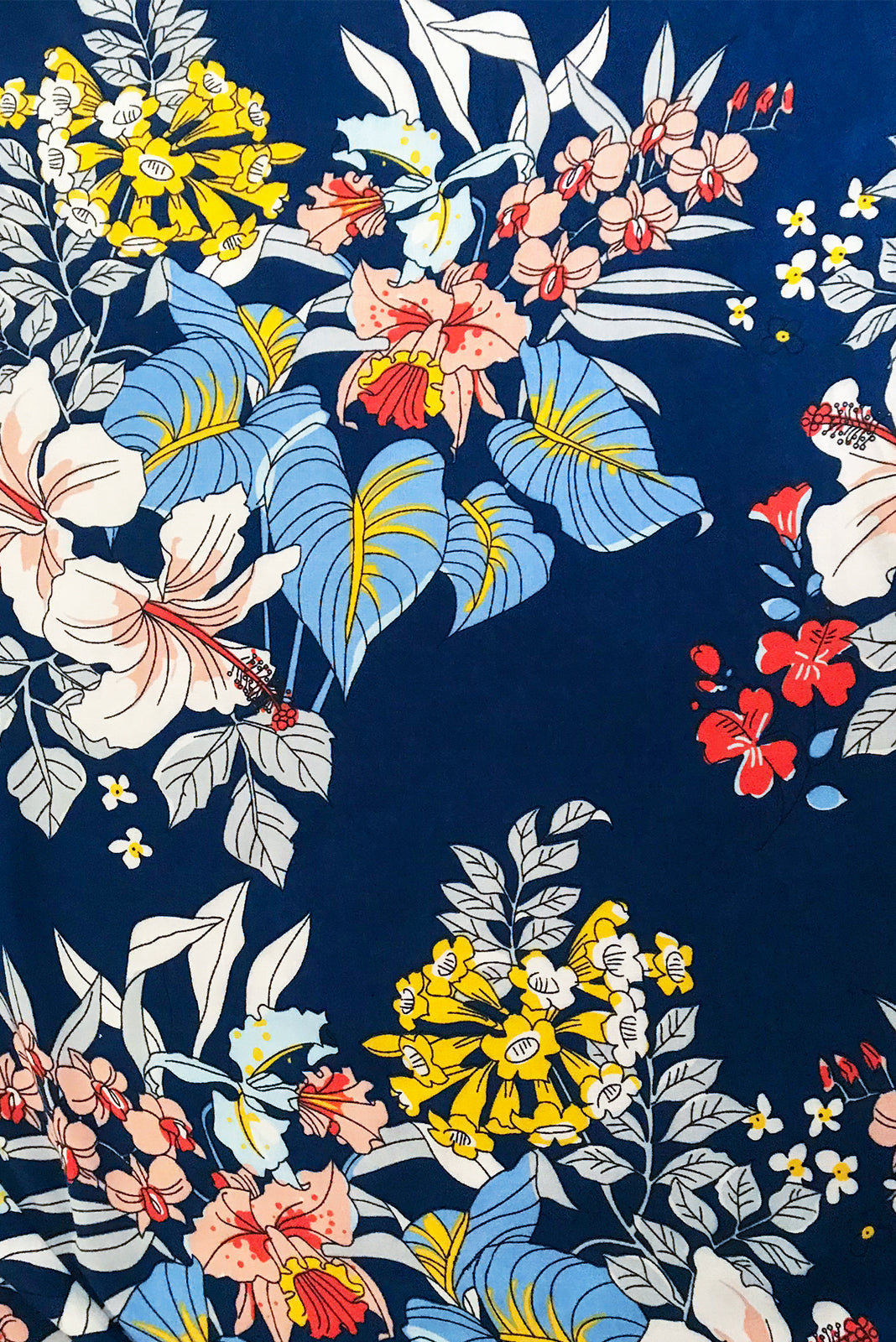 Fabric swatch of Petal Naviti Blue Maxi Wrap Dress features blue base with white, yellow, coral, peach and baby blue floral print in woven 100% rayon.