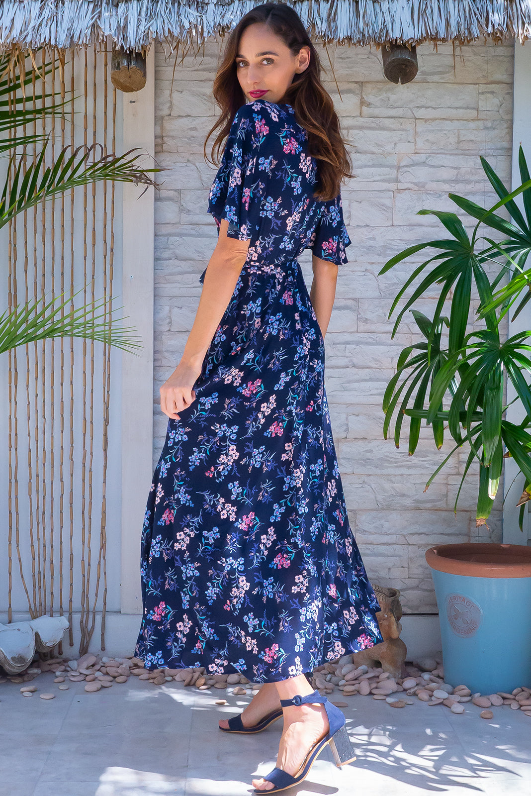 The Petal navy Magic Maxi Wrap Dress features elasticised waistband at back, floaty petal sleeves, deep side pockets and 100 % rayon in navy base with floral print.
