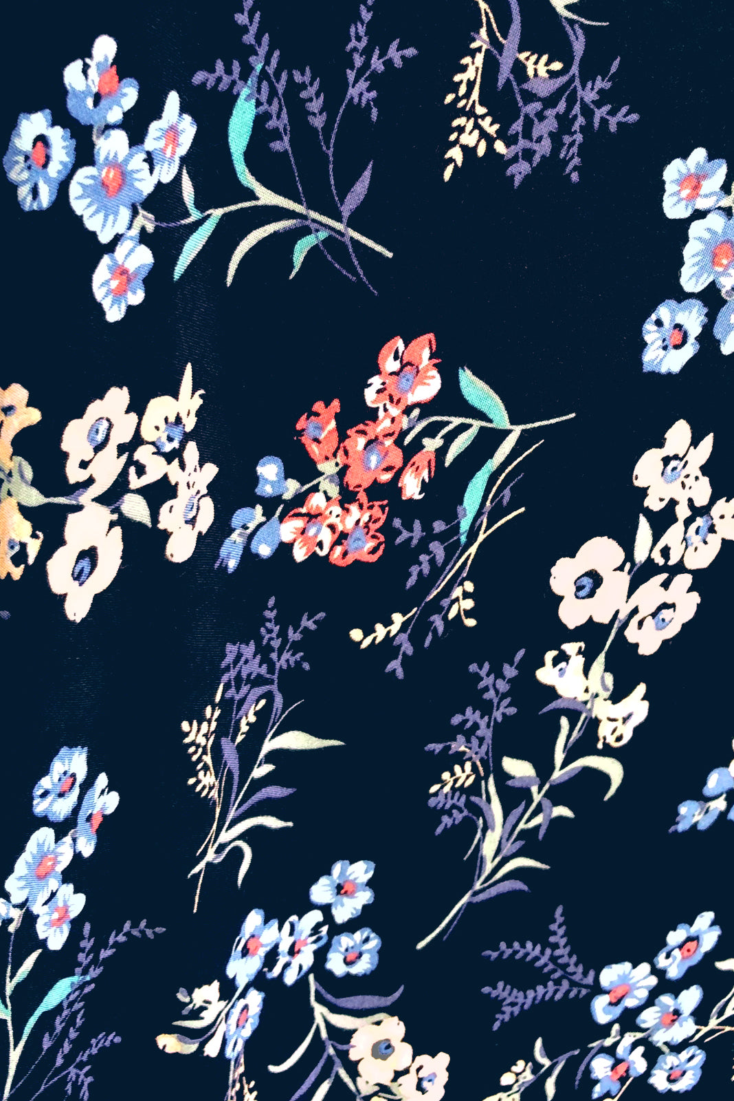 Fabric Swatch of Petal Navy Magic Maxi Wrap Dress featuring 100 % rayon in navy base with floral print.