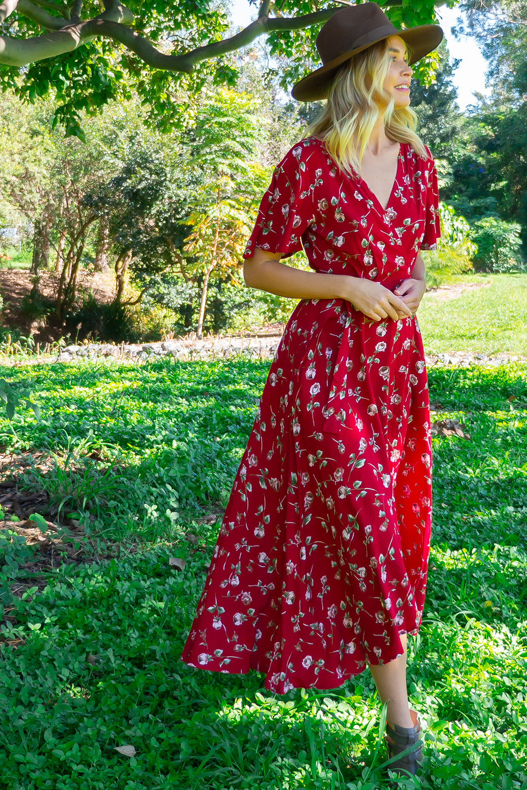 The Petal Red Rosebud Maxi Wrap Dress features plunging neckline, floaty petal sleeves, deep side pockets and 100 % rayon in red base with rose print.