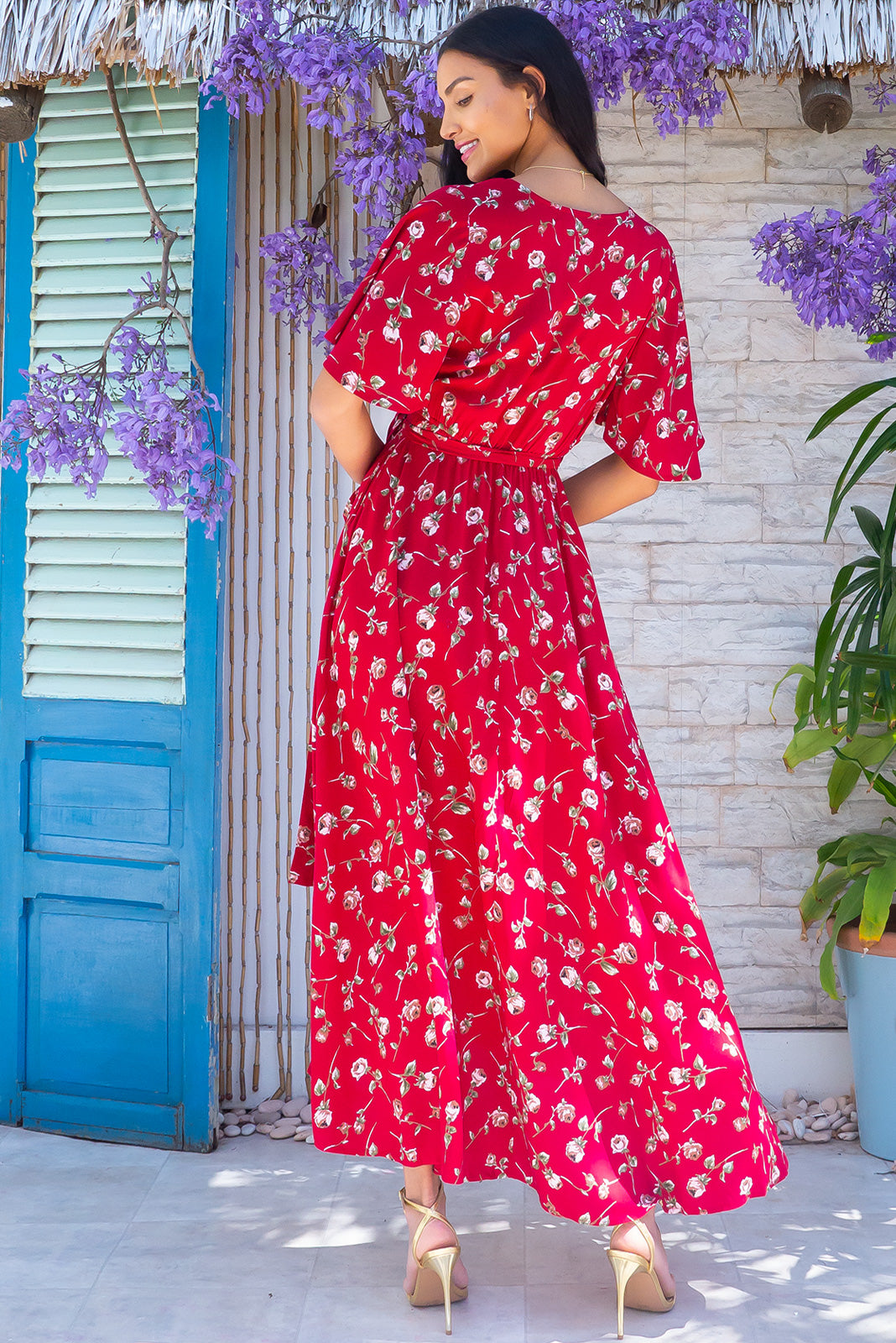 The Petal Red Rosebud Maxi Wrap Dress features plunging neckline, floaty petal sleeves, deep side pockets and 100 % rayon in red base with rose print.The Petal Red Rosebud Maxi Wrap Dress features plunging neckline, floaty petal sleeves, deep side pockets and 100 % rayon in red base with rose print.