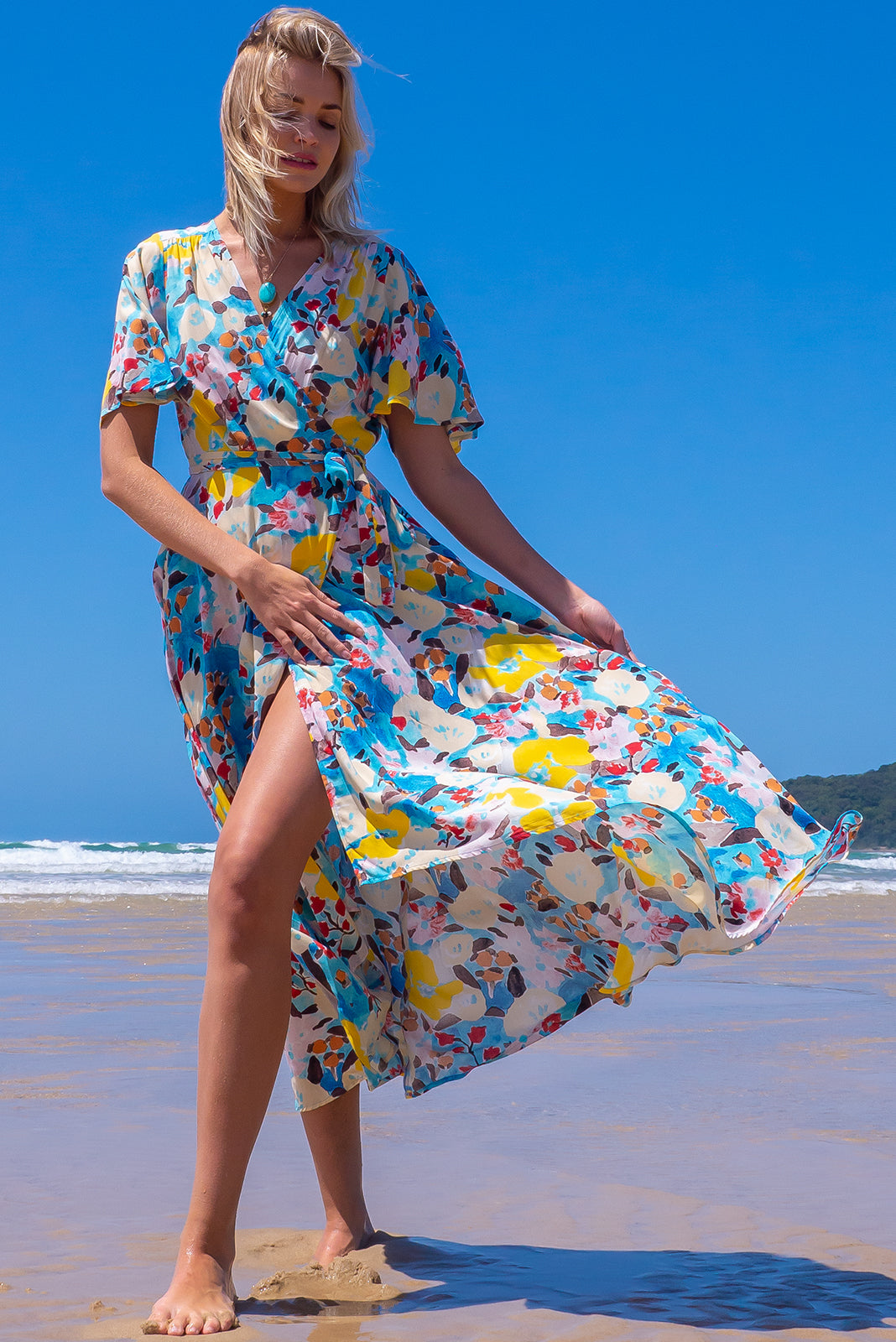 The Petal Watercolours Maxi Wrap Dress features plunging neckline, ties at waist, elasticised waistband at back, floaty petal sleeves, deep side pockets and 100% rayon in watercolour print in blues and yellows.