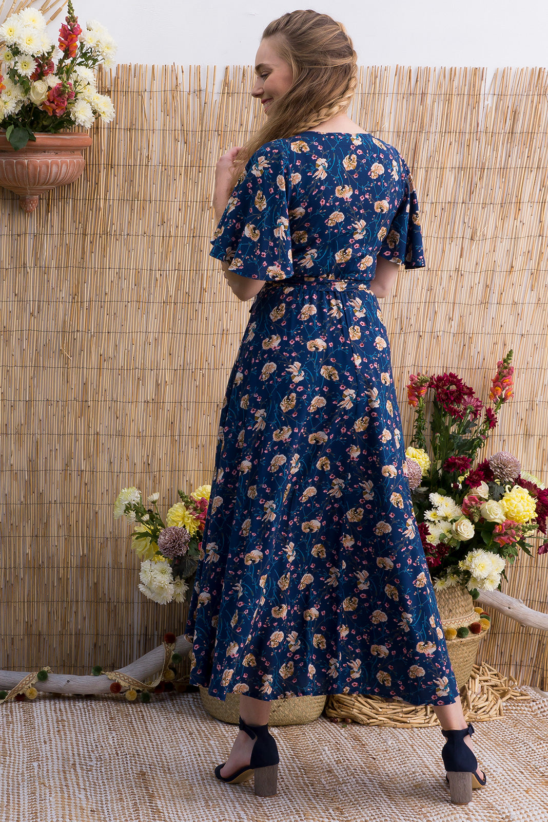 Petal 8 Navy Scatterlings Maxi Wrap Dress features a dusty navy base with a dainty floral bohemian print on a soft woven rayon