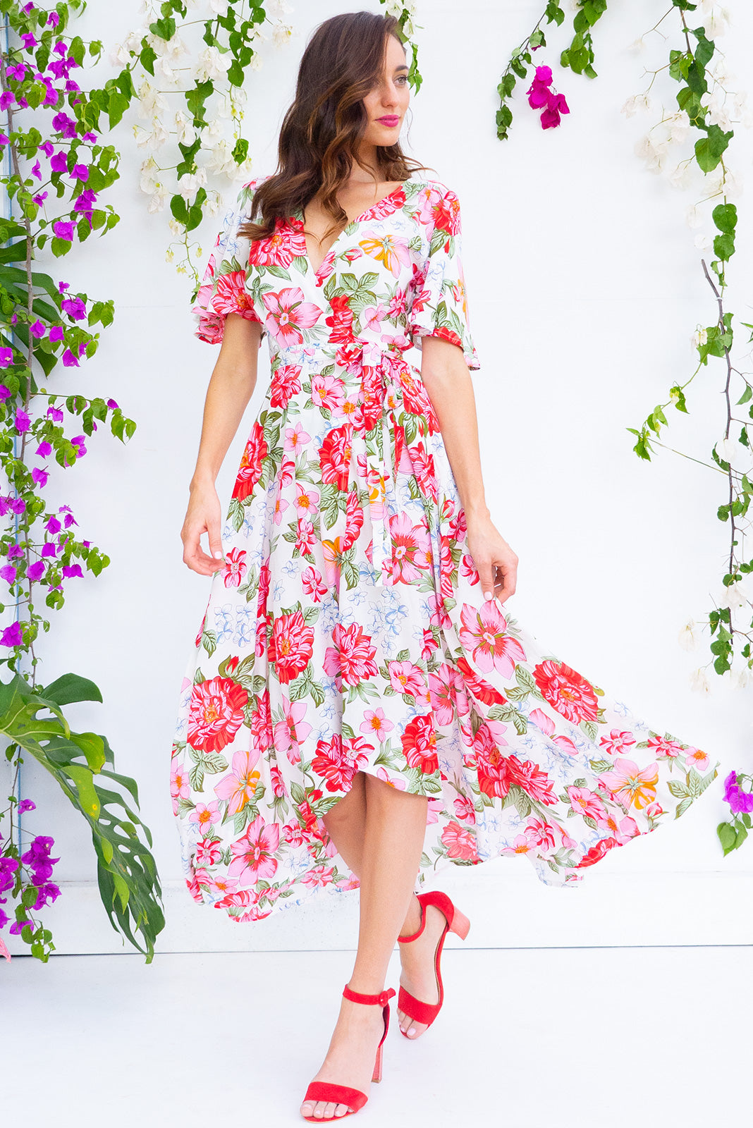 bfcafccde84 Petal Azalea Pinks Maxi Wrap Dress features a flutter sleeve