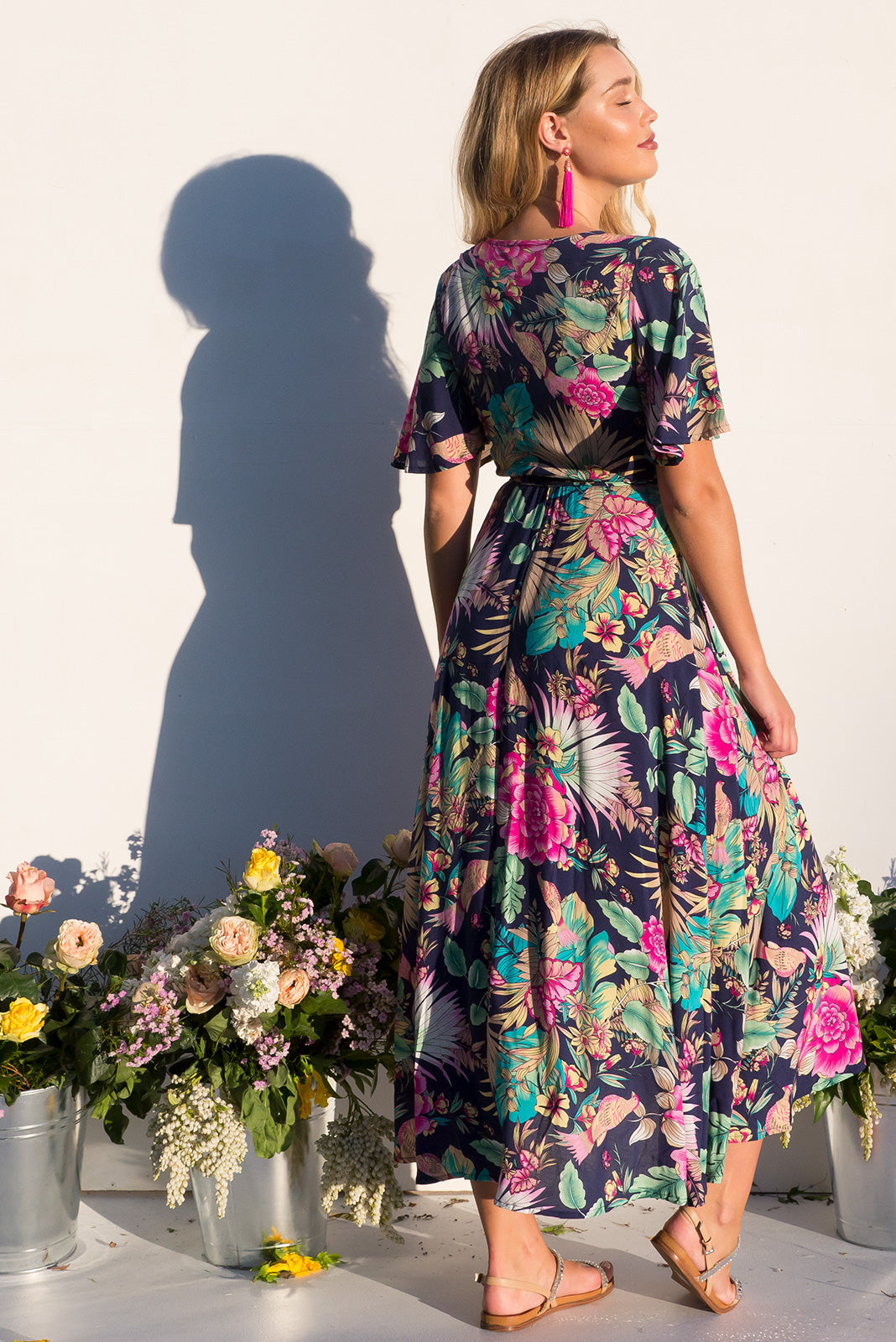 Petal Bird of Paradise Maxi Wrap dress with flutter sleeves in a vibrant navy and brightly coloured tropical print plus size dress