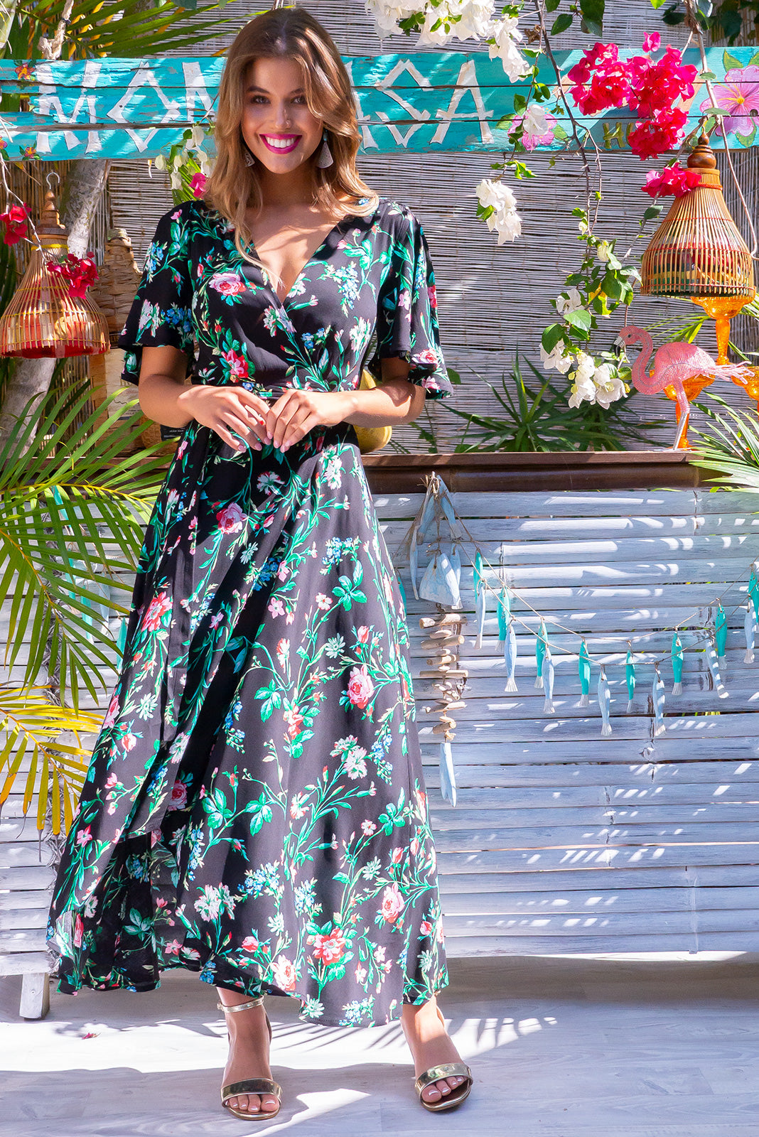Petal Cotswold Noir Maxi Wrap Dress black based bohemian print rayon design. True wrap dress with flutter sleeves.