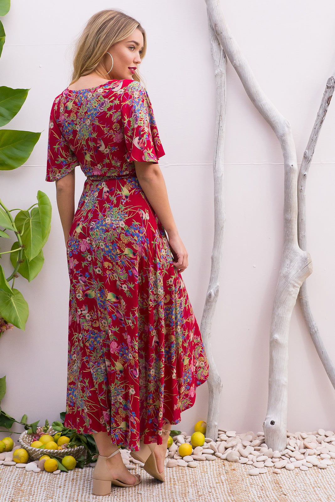 Petal Crimson Honey Eater Maxi Wrap Dress features a bold red base with a floral bohemian print on a soft woven rayon and has a petal sleeve and wrap around shape