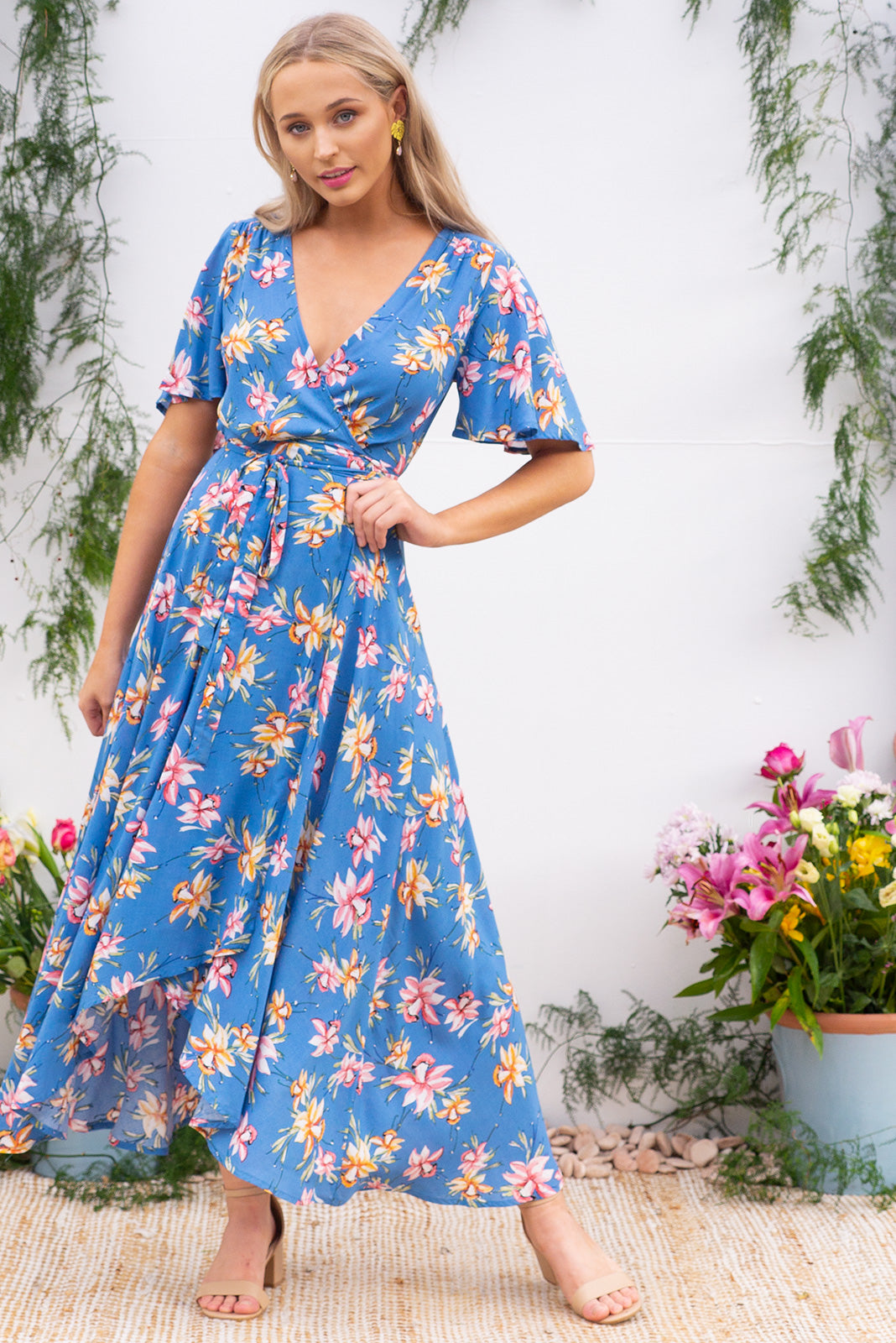 90f1c5c6a193 Petal Daffodil Skies Maxi Wrap Dress features a beautiful sky blue base  with a daffodil inspired