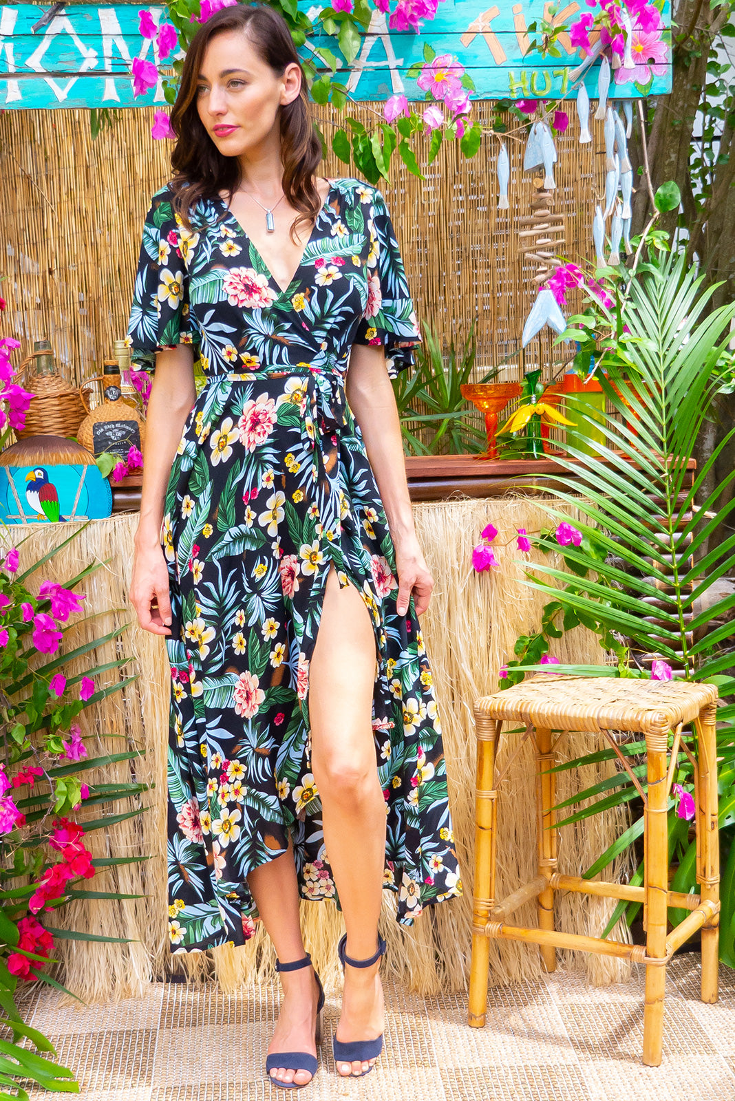 Petal Forest Floral Noir Maxi Wrap dress features a flattering wrap around waist, petal sleeves, and a shorter at the front hemline and comes in a deep black jungle inspired bohemian floral print on rayon