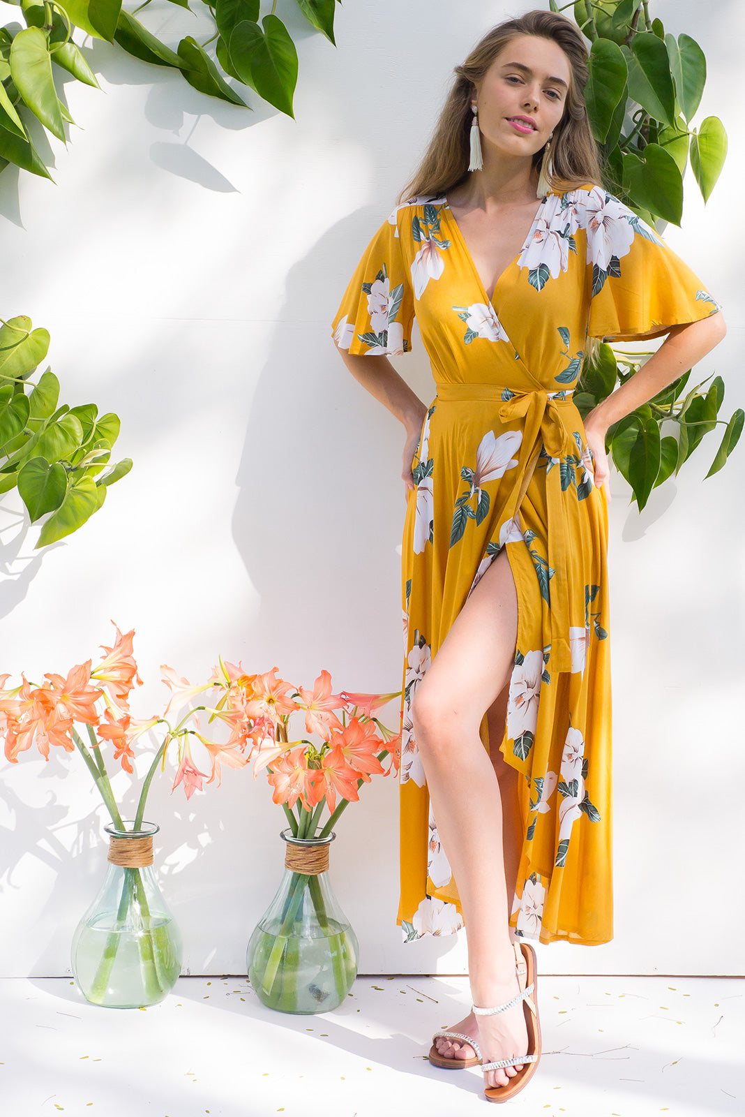 Petal Gardenia Gold Maxi Wrap dress with flutter sleeves in a vibrant gold and white romantic gardenia flower print