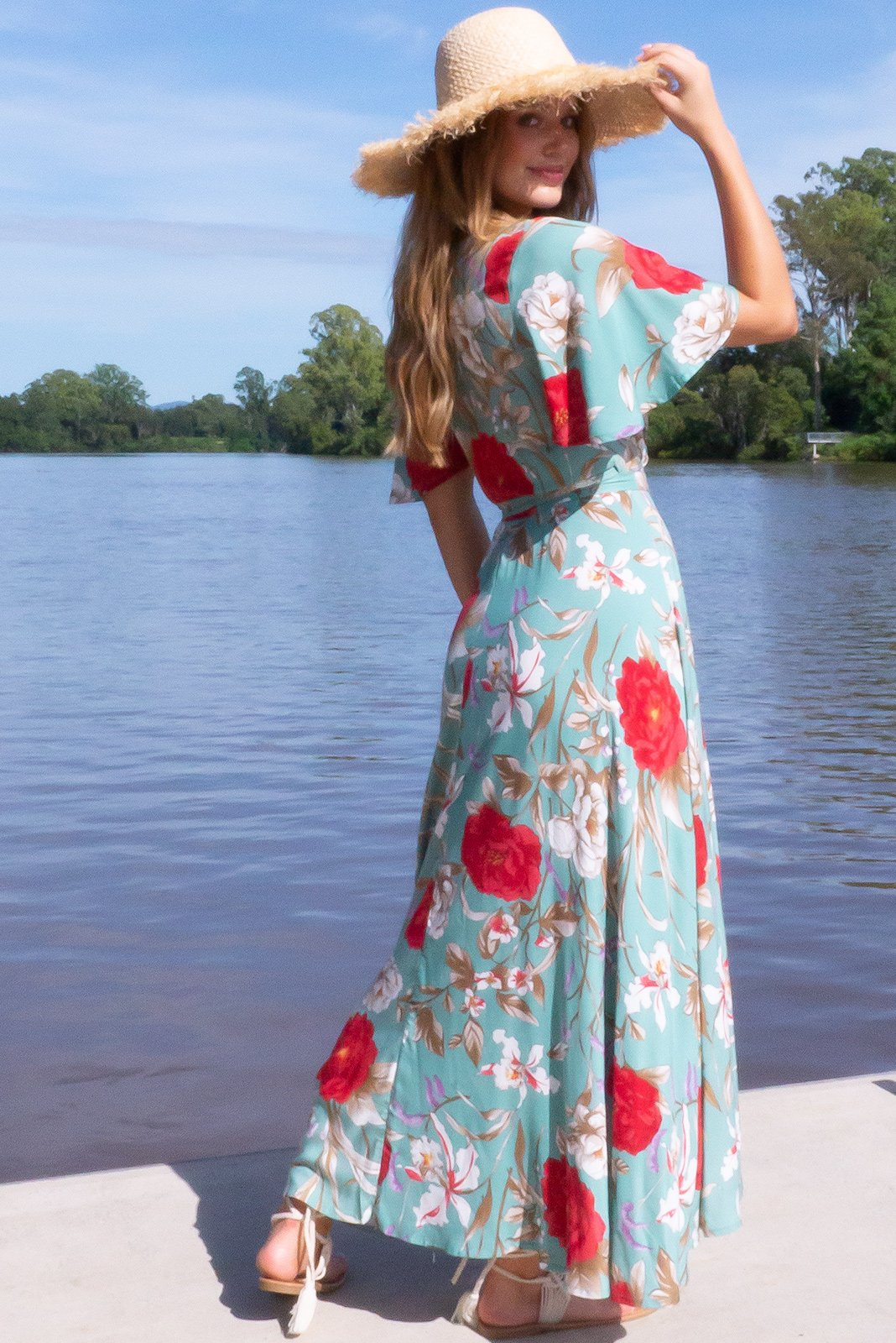 Gorgeous bohemian frock, Petal Josephine Sage Maxi Wrap Dress has midi length at front, maxi length at back, ties at waist, elasticised waistband at back, floaty petal sleeves, teal blue base with crimson, white, lavender and taupe floral print. in woven 100% rayon.