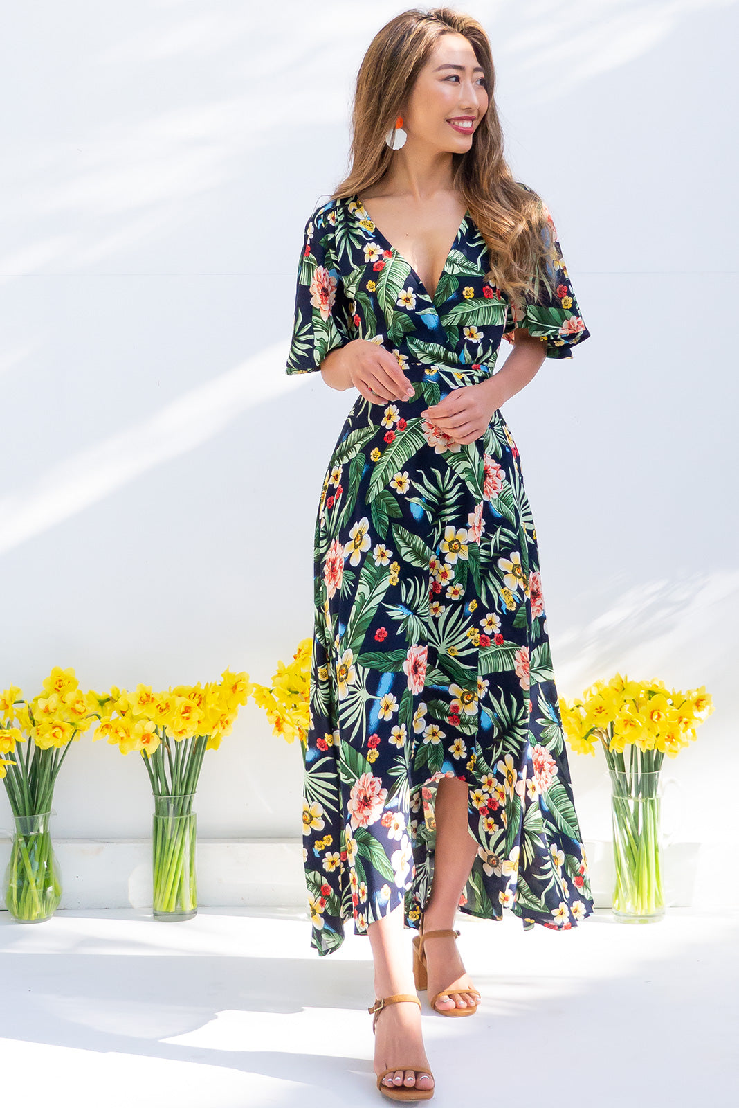 Petal Jungle Noir Maxi Wrap Dress made from 100% rayon, summer tropical vibe, true wrap design, flutter sleeves.