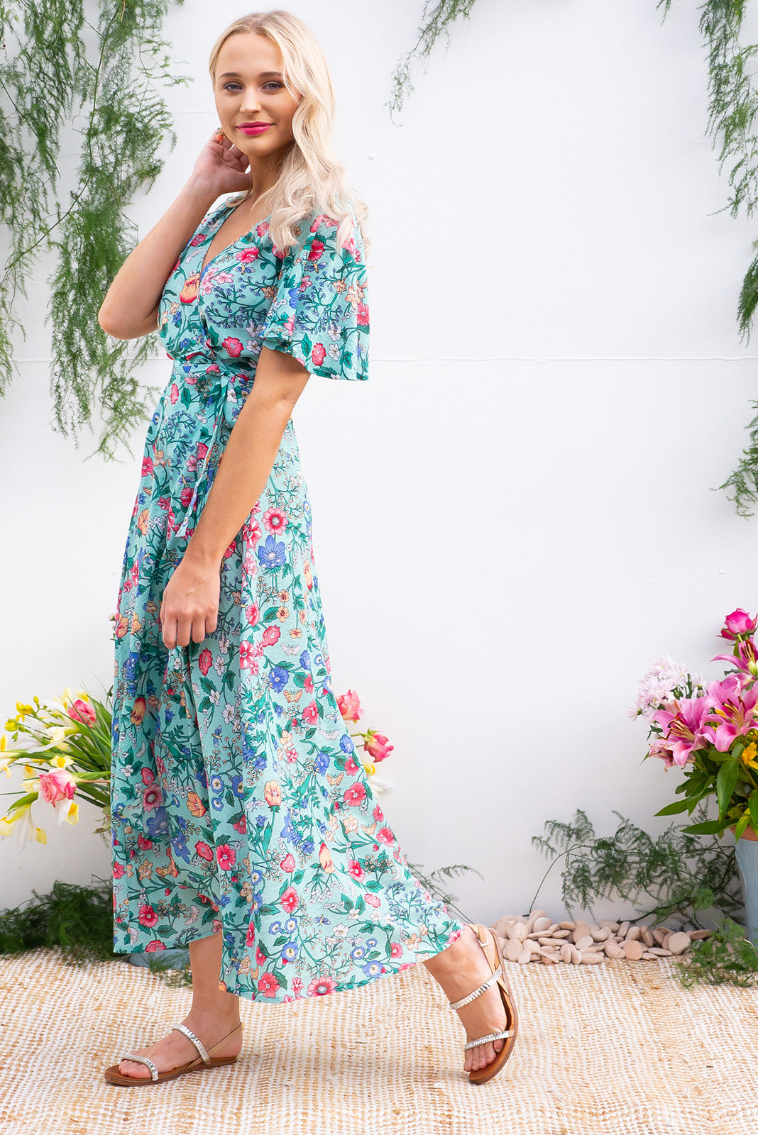 Petal Minty Meadow Cotton Maxi Wrap Dress features a strong aquamarine base with a floral bohemian print on a soft woven rayon and has a petal sleeve and wrap around shape