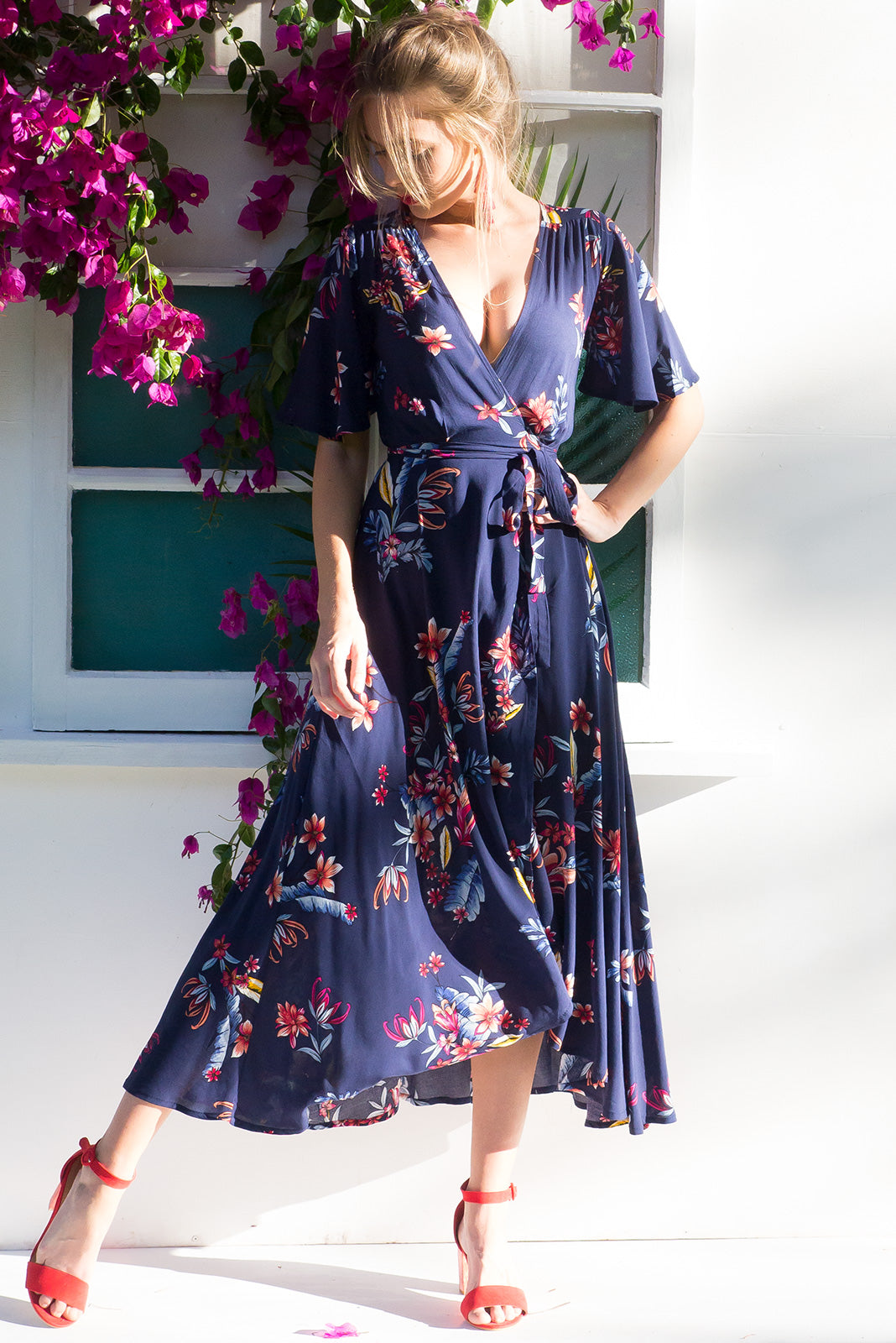 Petal Newport Navy Maxi Wrap dress with flutter sleeves and bright navy and floral print on rayon fabric