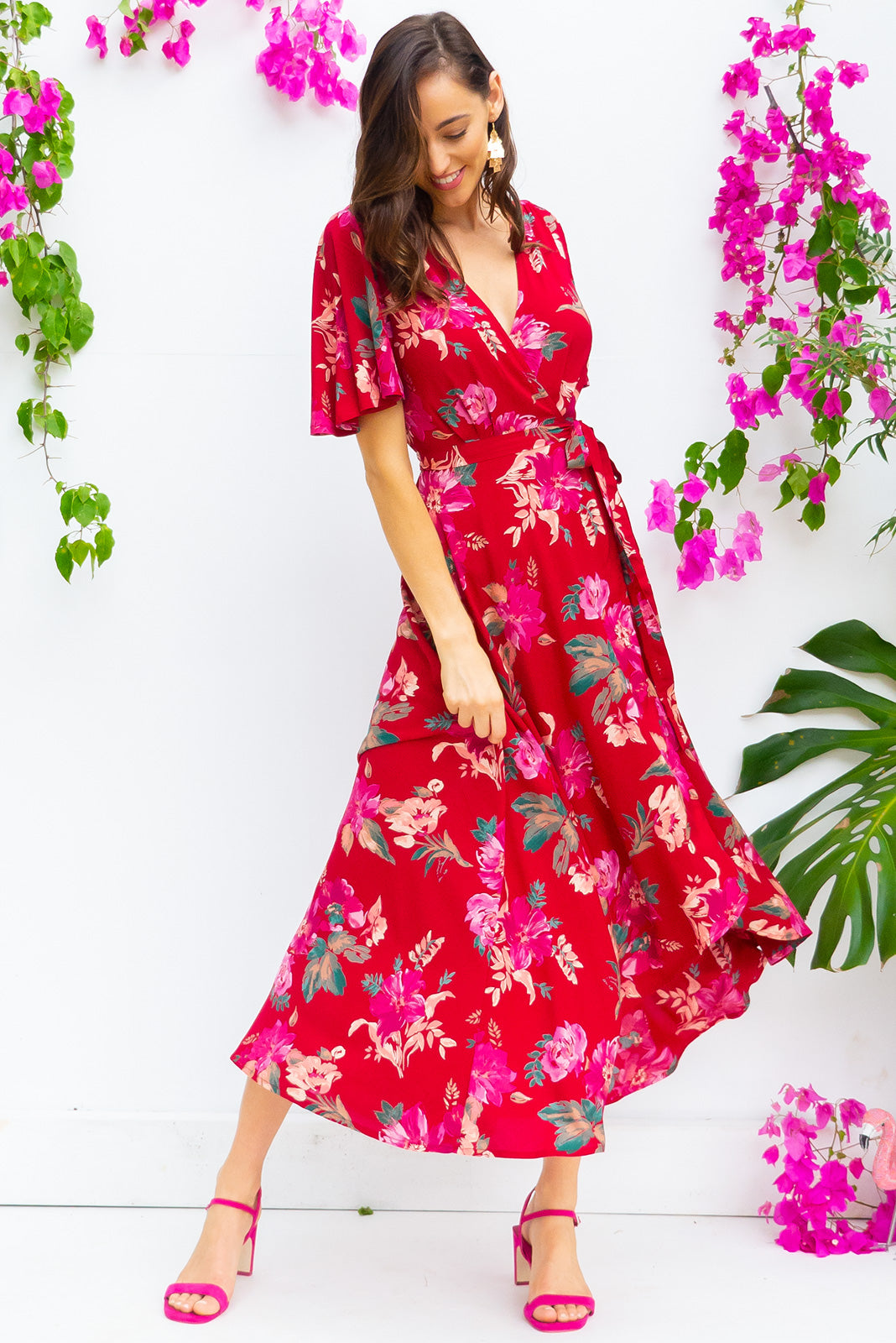Petal Red Romance Maxi Wrap Dress dress features a flattering wrap around waist, petal sleeves, and a shorter at the front hemline and comes in a bold red watercolour roses  bohemian floral print on rayon