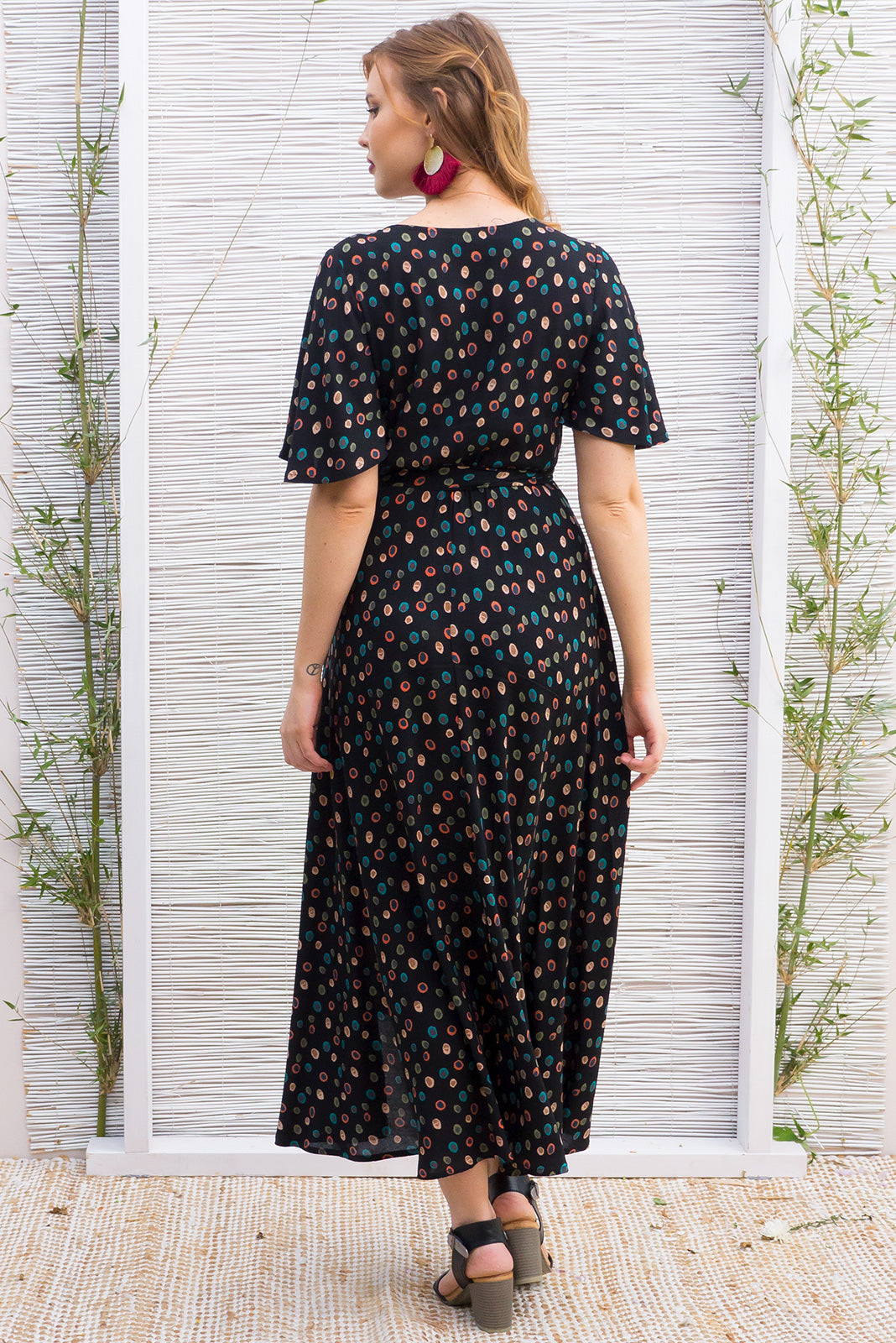 Petal Retro Spot Maxi Wrap Dress features a retro vintage inspired avant garde spot print on a soft woven rayon which wraps around the front and has a spot petal sleeve
