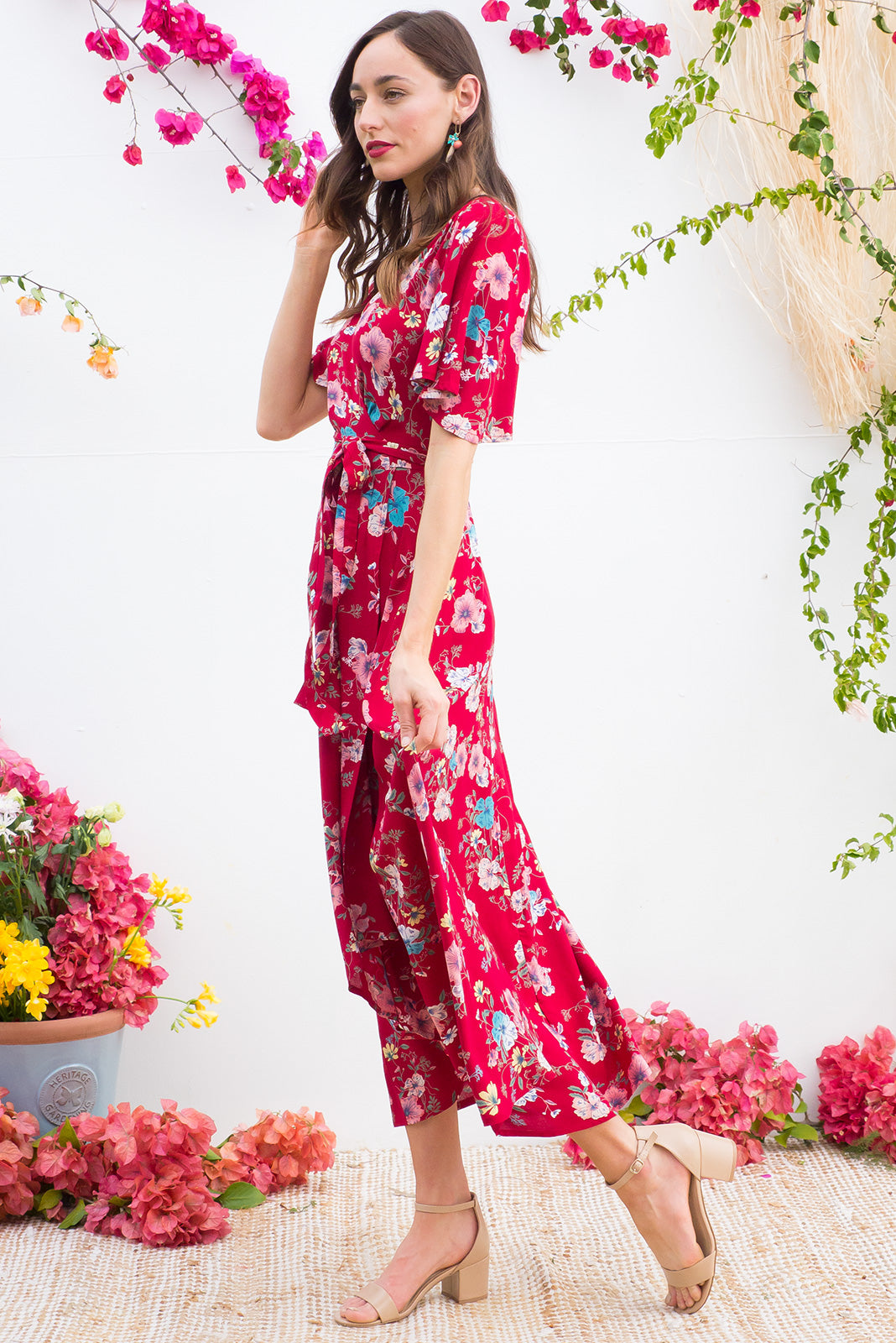 Petal Sangria Red Maxi Wrap Dress features a bold red base with a floral bohemian print on a soft woven rayon and has a petal sleeve and wrap around shape