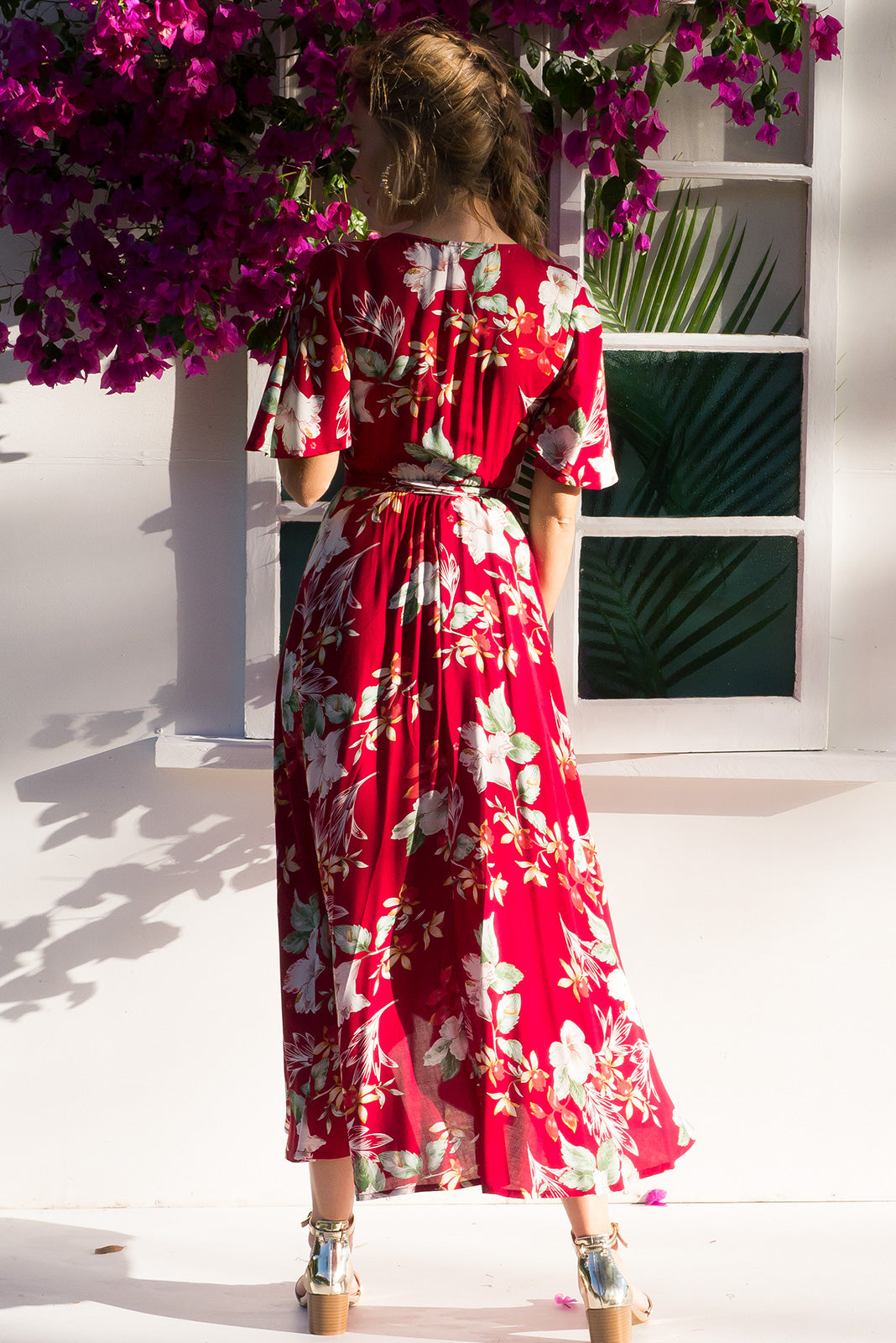 Petal Sweet Heart Maxi Wrap dress with flutter sleeves and a stunning bright red tropical floral print