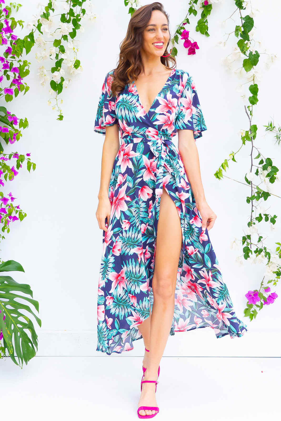 Petal Tiger Lilly Maxi Wrap dress with flutter sleeves in a vibrant blue based tropical inspired floral print on 100% woven rayon