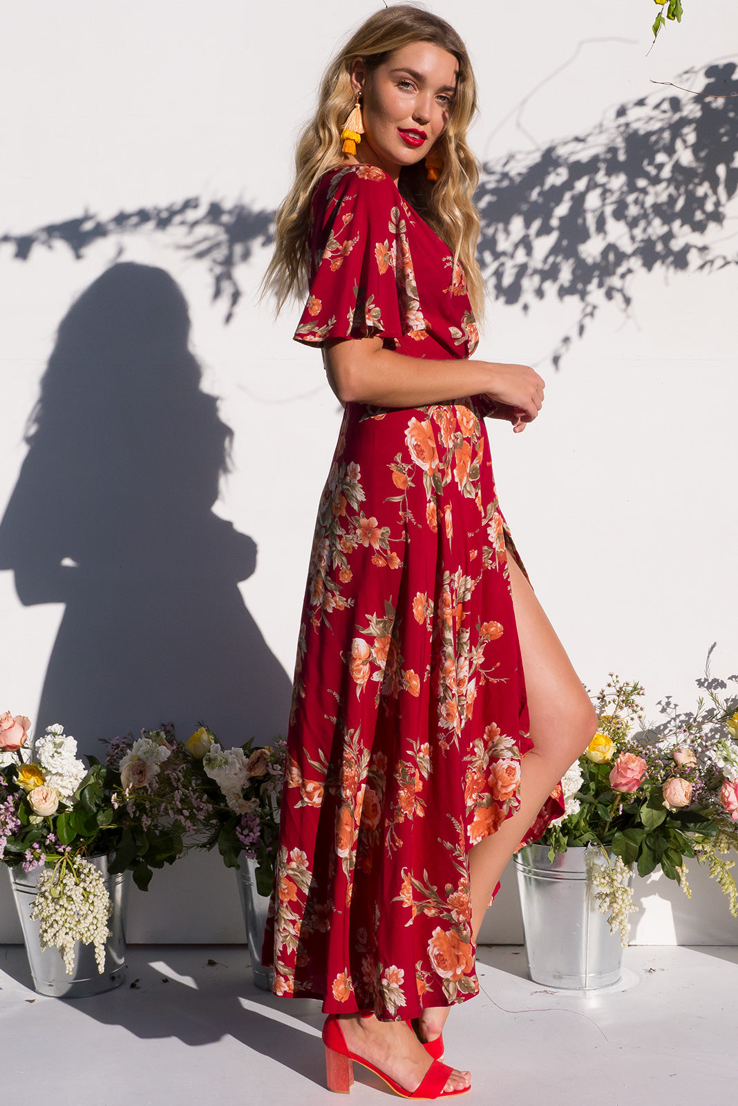 Petal Wine and Roses Maxi Wrap dress with flutter sleeves and a vibrant red with peachy pink roses print
