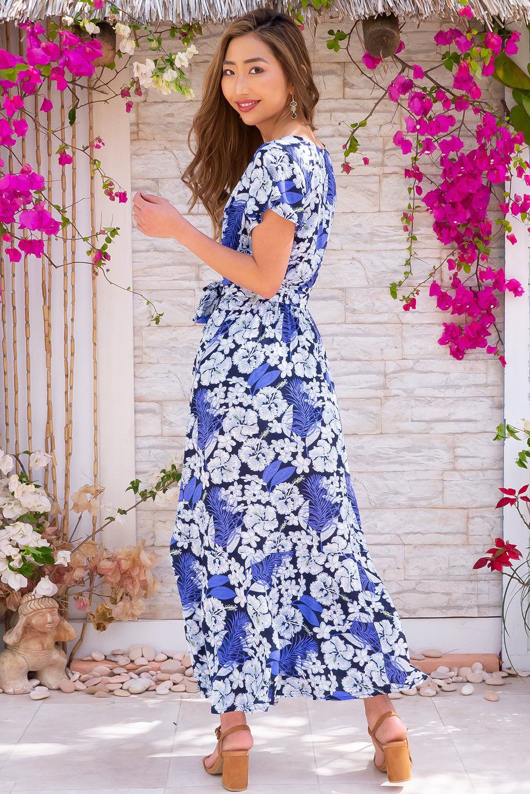 Phinda Blue Island Maxi Wrap Dress, 100 % rayon, bohemian summer style, side pockets, adjustable wrap design, elasticated back waistband, navy base with large white and blue floral print.