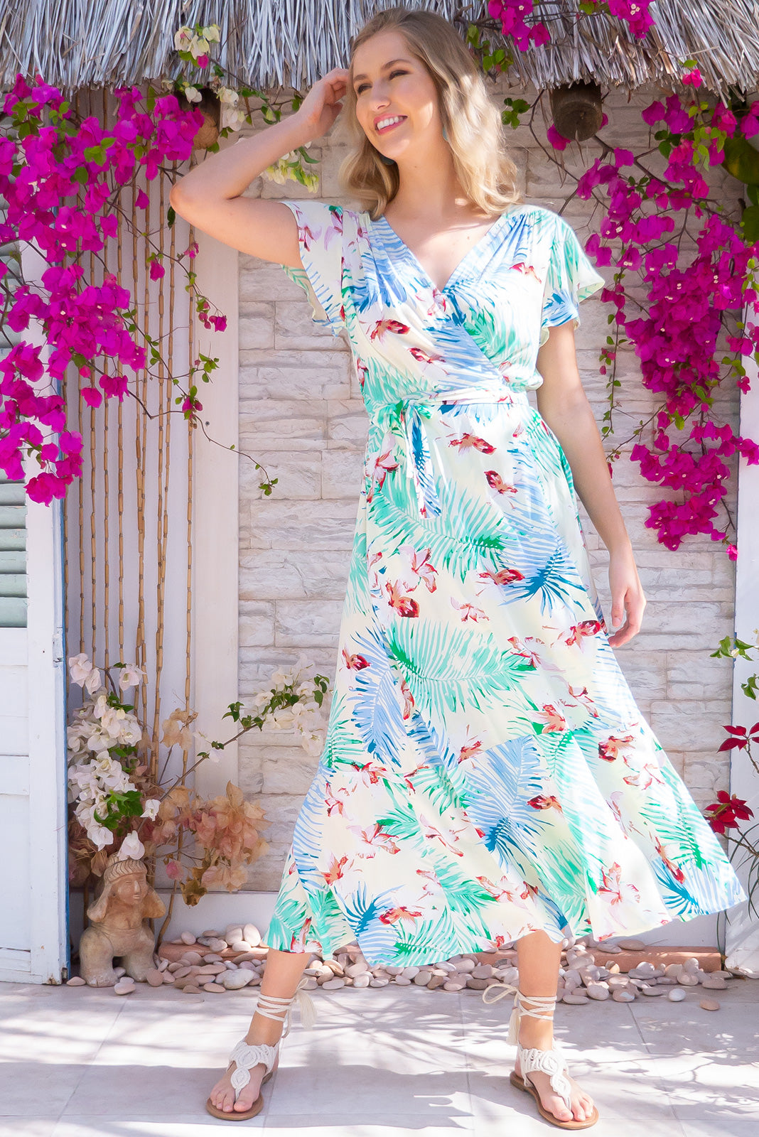 Phinda Pacific Maxi Wrap Dress is the perfect tropical summer dress. Featuring adjustable waist, short flutter sleeves and side pockets.