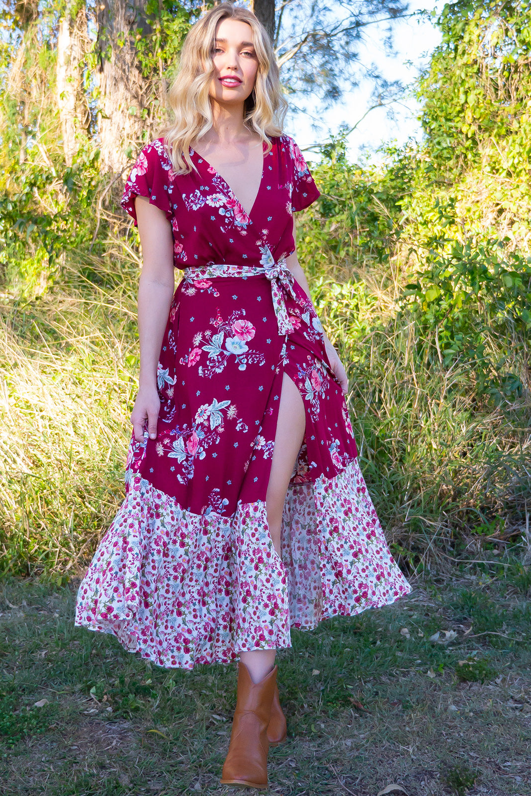 Phinda Rosella Red Maxi Wrap Dress with a relaxed fit bodice, short petal sleeve and frill around the hem in a patchwork of romantic raspberry red floral and ditzy white bohemian floral on a woven 100% rayon