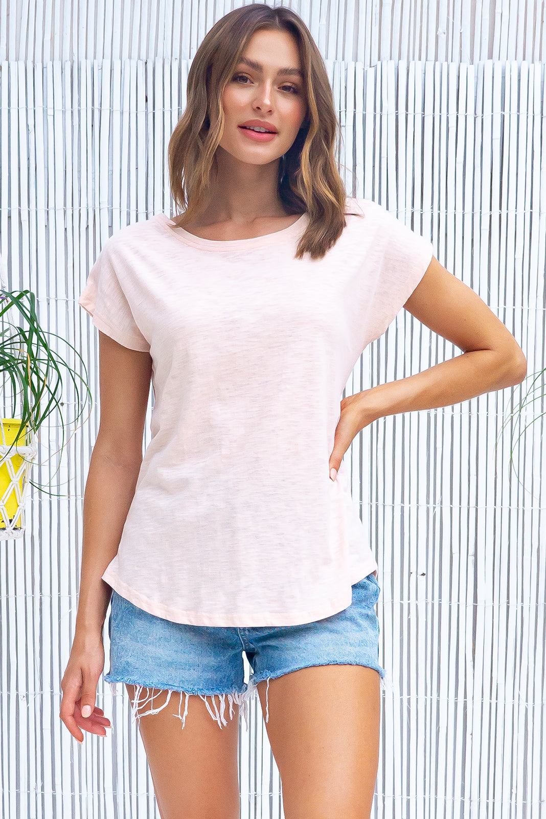 The Phoenix Tee Palest Apricot is a oversized classic T-shirt featuring  ultra lightweight,  curved hem and Knit 100% cotton in pale, dusty apricot/nude tone.