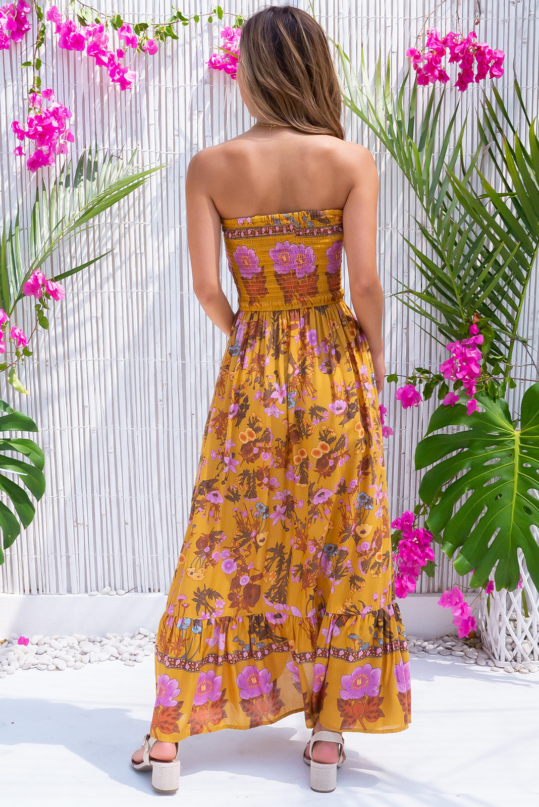 Poetry Rhodes Gold Maxi Dress, bohemian summer style, side pockets, elasticated shirred bodice, deep caramel gold base with medium floral print featuring pops of purple.