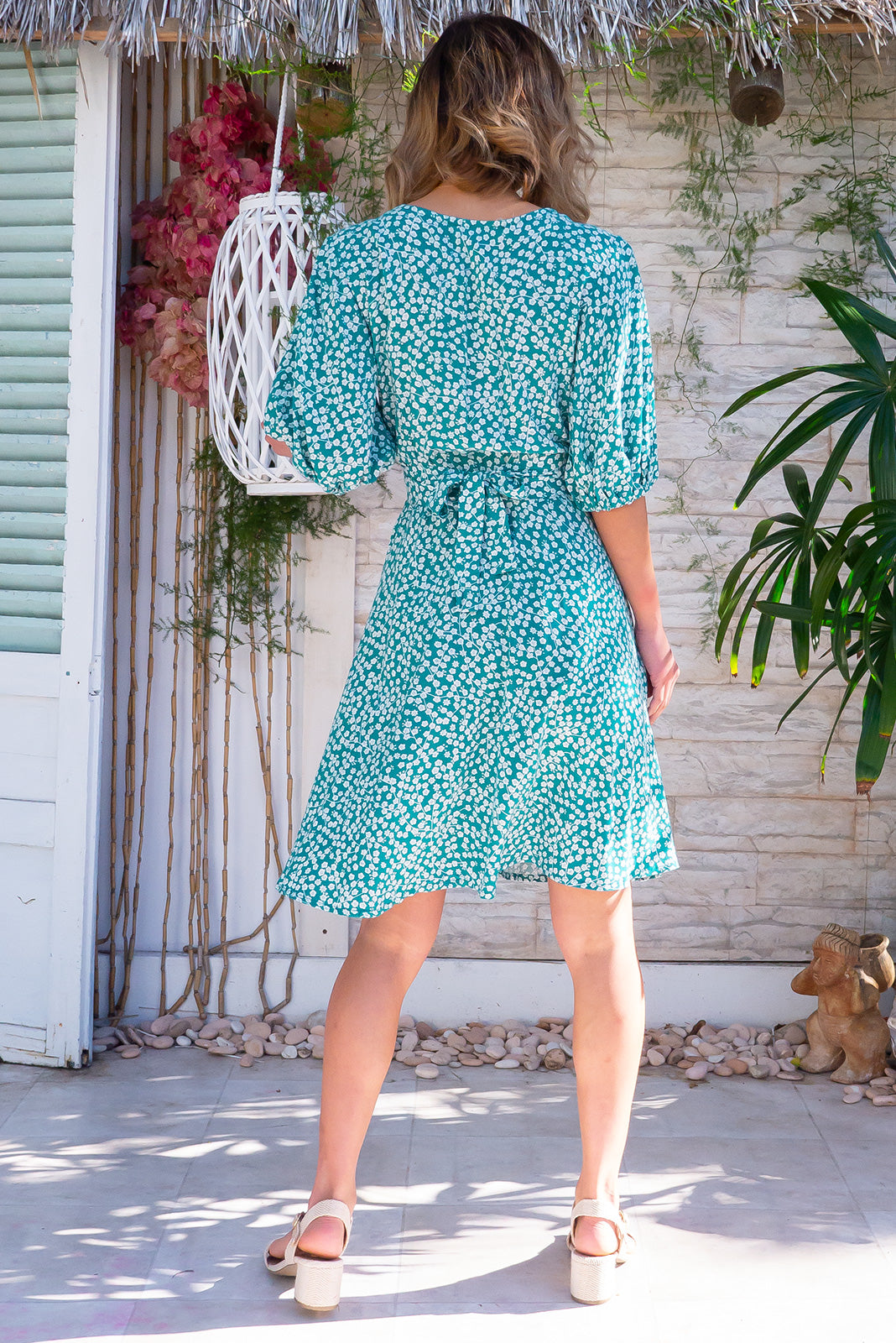 The Poppi Kelly Green Wrap Dress is flattering adjustable wrap design featuring elasticated waist band at the back, puff sleeves and 100 rayon in fresh green base with white floral print.