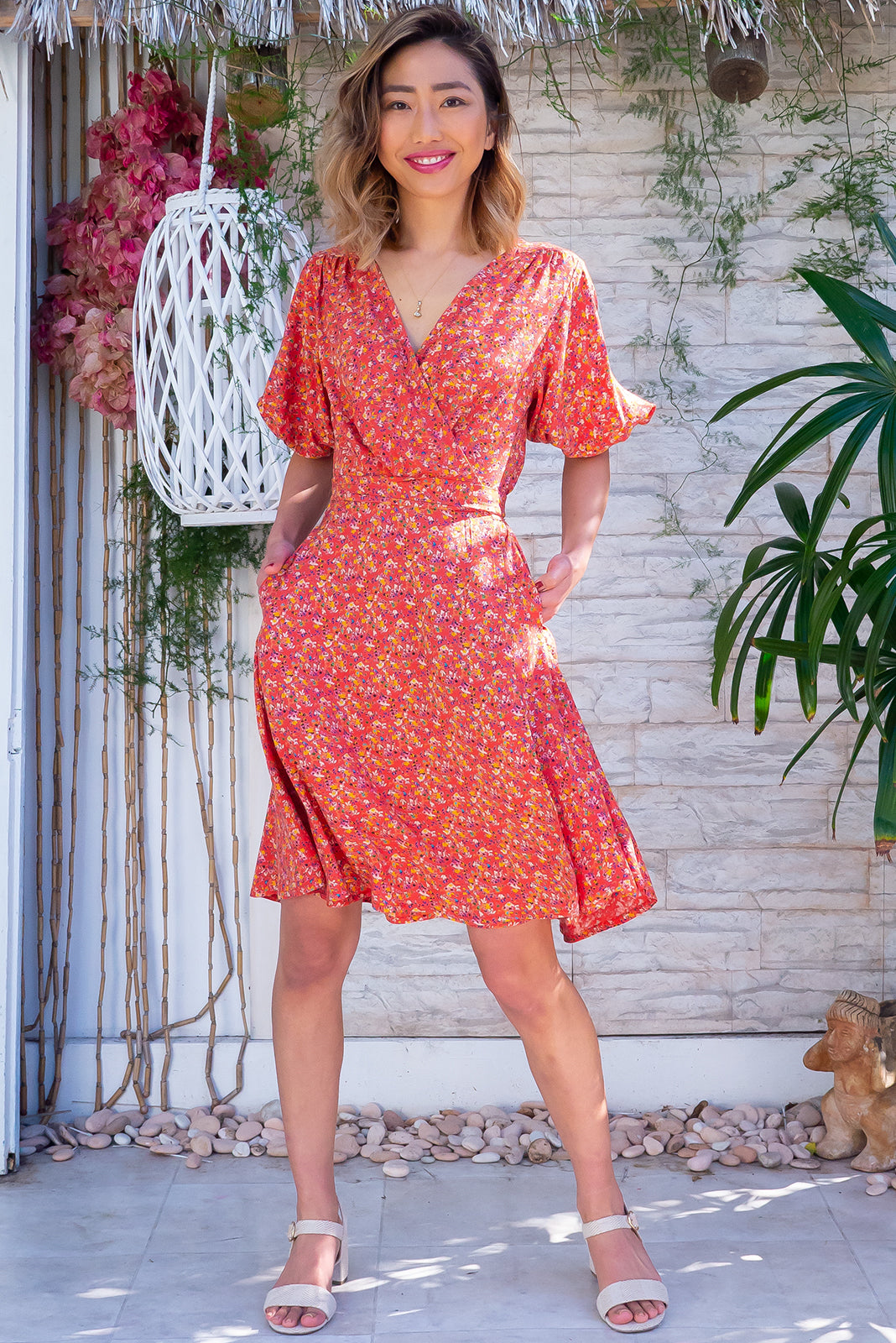 The Poppi Tuscan Orange Wrap Dress features flattering adjustable wrap design, elasticated waist band at the back, puff sleeves, side pockets and 100% rayon in terracotta base with ditzy print.