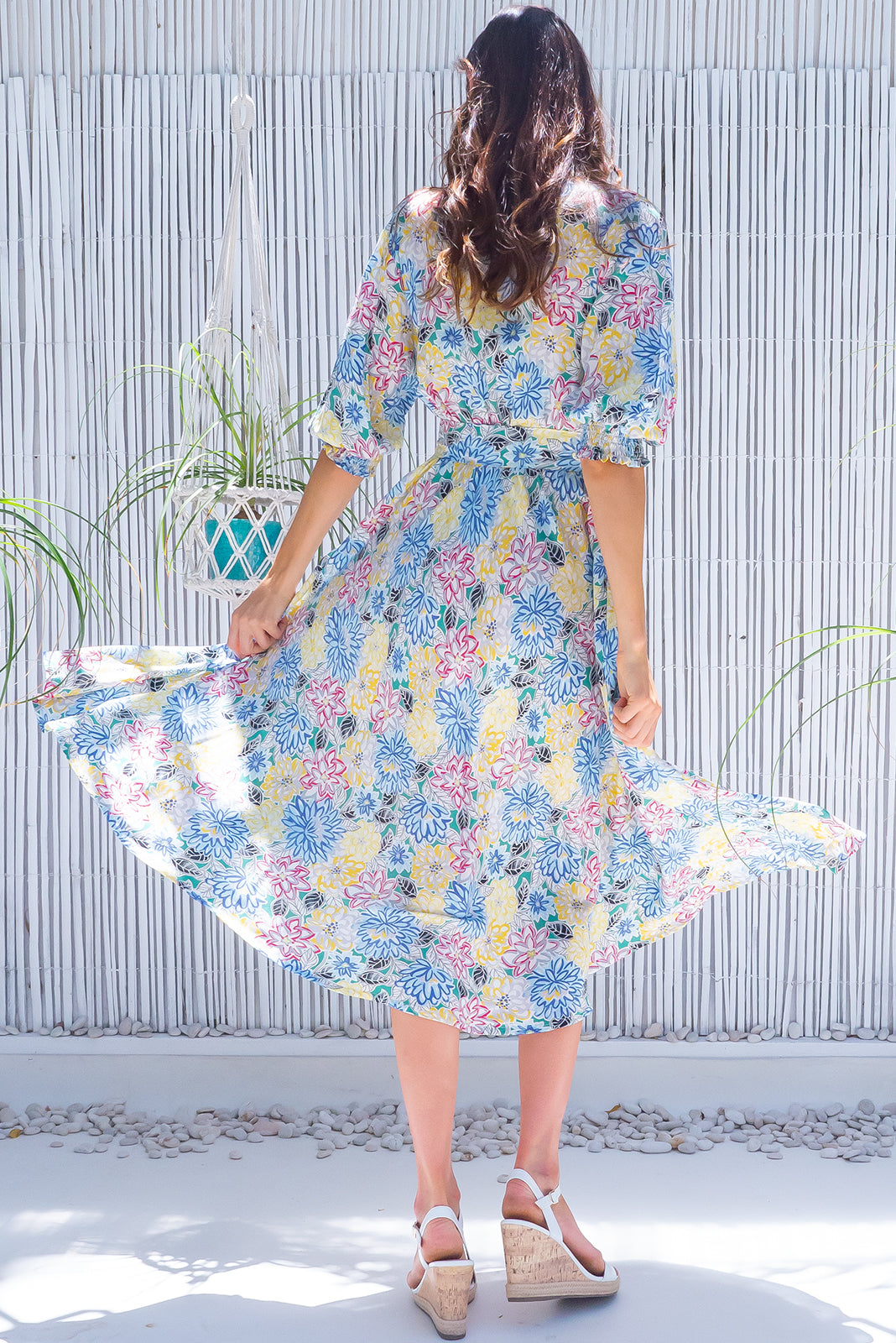 The Primrose Garden Sketch Dress is a vintage inspired frock featuring V neckline, functional buttons from bust to waist, 3/4 sleeve with shirring cuffs, side pockets and 100% rayon in white base with colourful floral outlines.