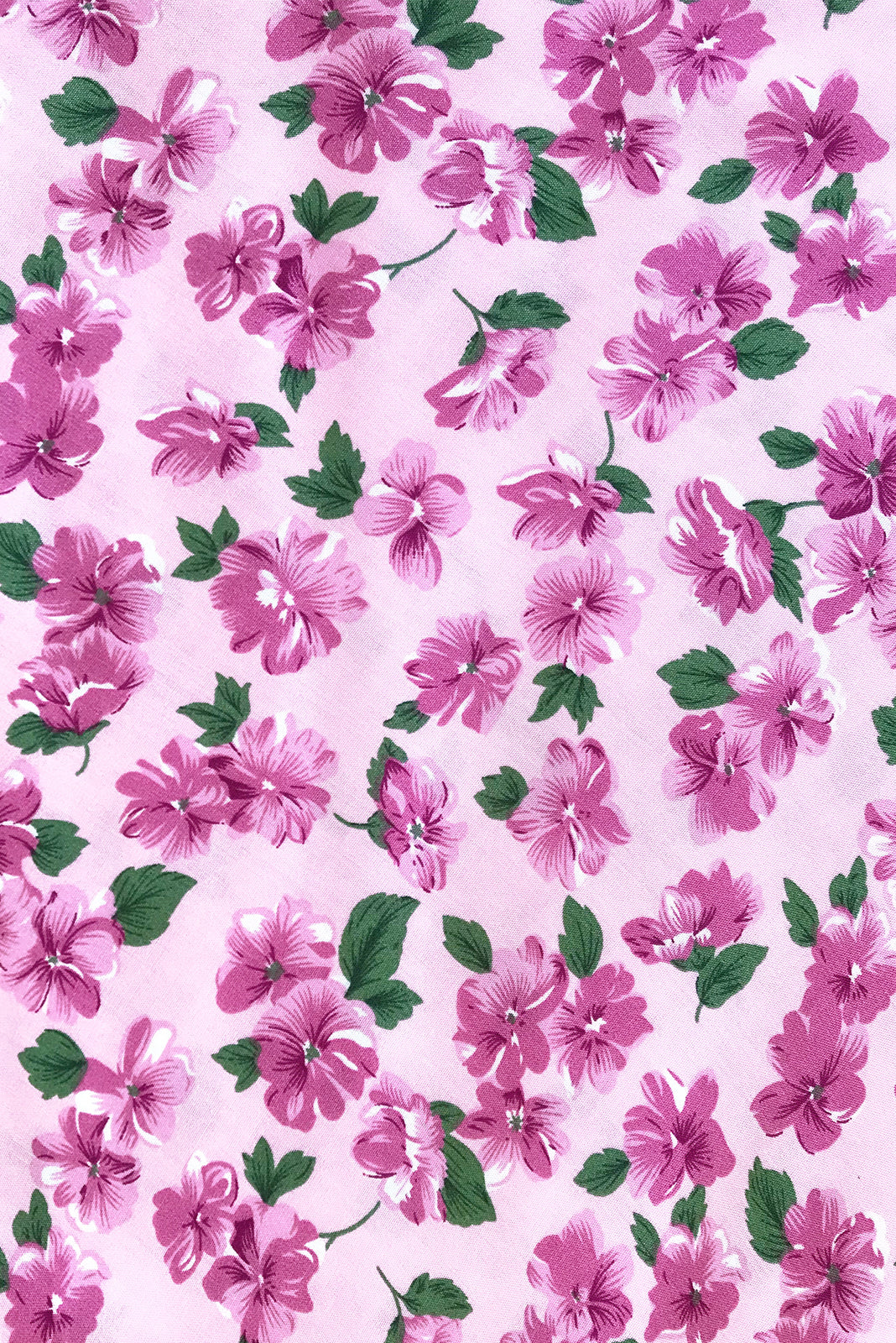 Fabric Swatch of Primrose In he Pink Dress featuring 100% rayon in pink base with mauve floral print.
