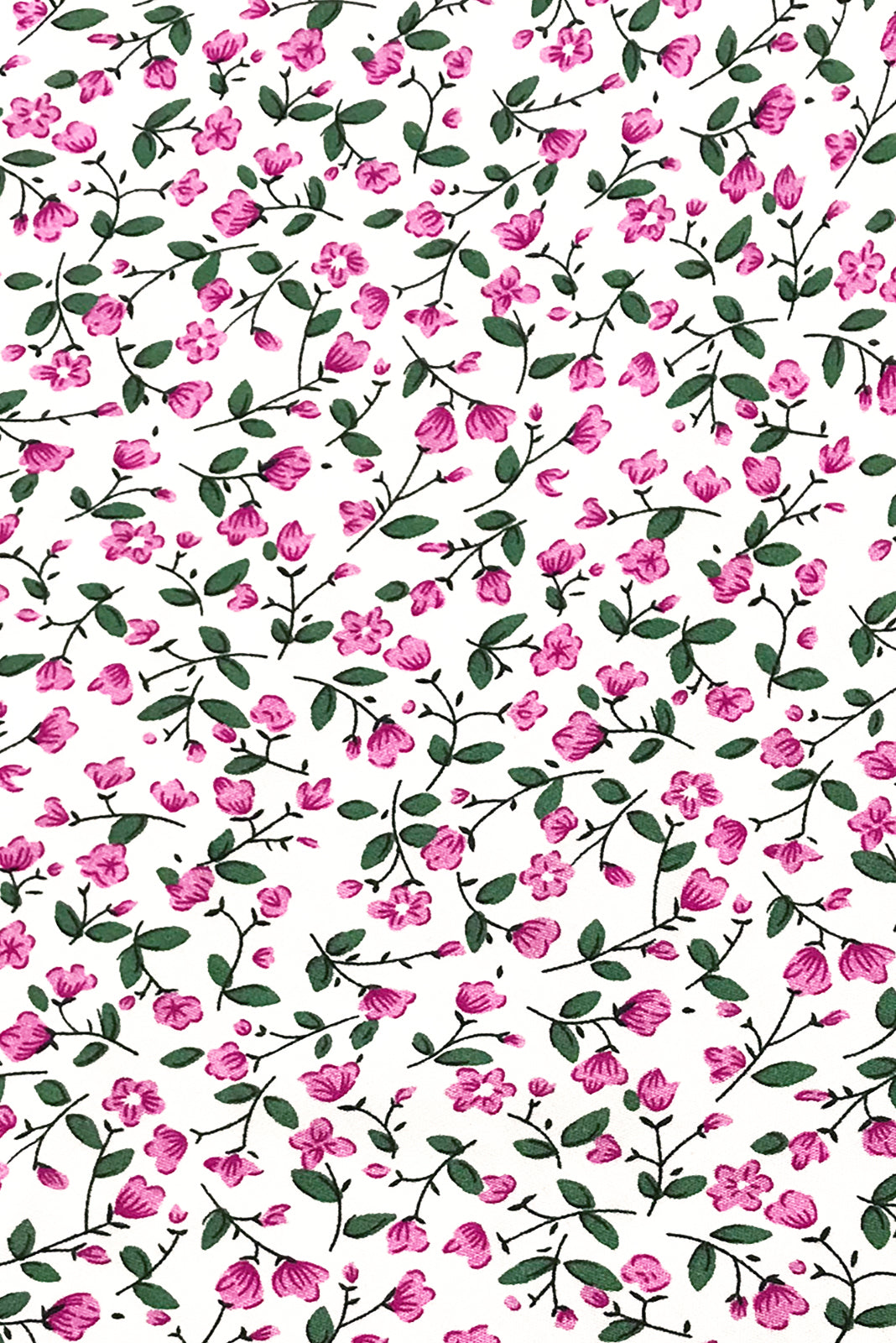 Fabric Swatch of Primrose Portia Pink Dress comes in woven 100% rayon in white base with mini pink and green floral pattern.