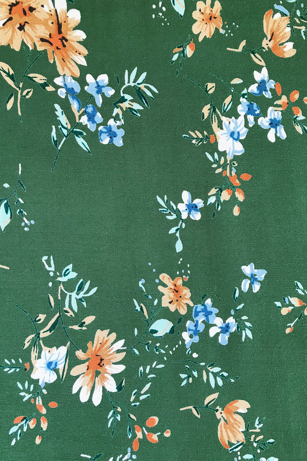 Fabric Swatch of Primrose Springtime Green Dress featuring 100% rayon in green base with classic floral print.