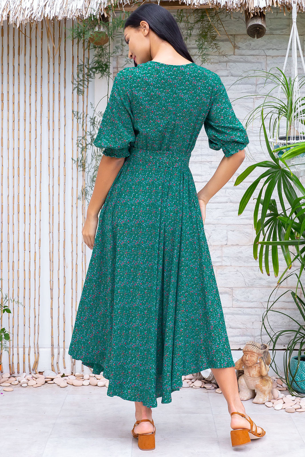 The Primrose Turkish Teal Dress is a V neckline midi dress featuring functional buttons from bust to waist, elasticated back waistband, 3/4 sleeve with shirring cuffs, side pockets, slightly curved hemline and 100% rayon in deep, teal base with ditzy floral print.