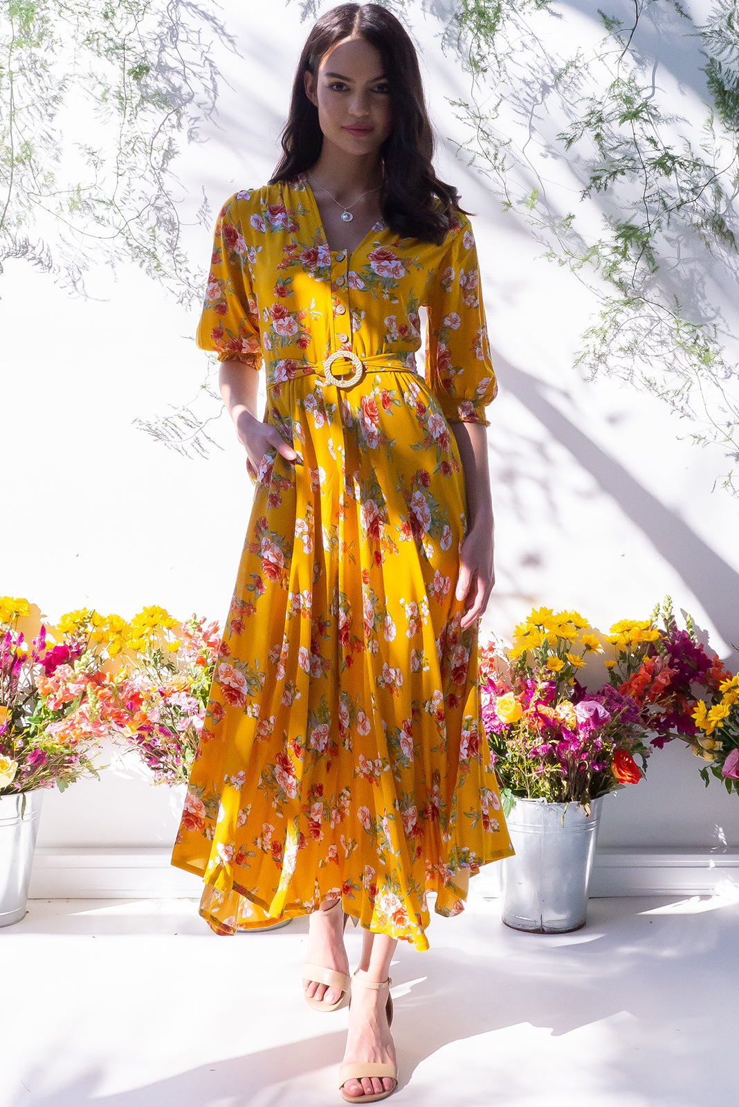 A dreamy dress, Primrose Texas Gold Dress features functional buttons from bust to waist, elasticated back waistband, side pockets and woven 100% rayon in rich, gold base with peach, white and amber floral print.