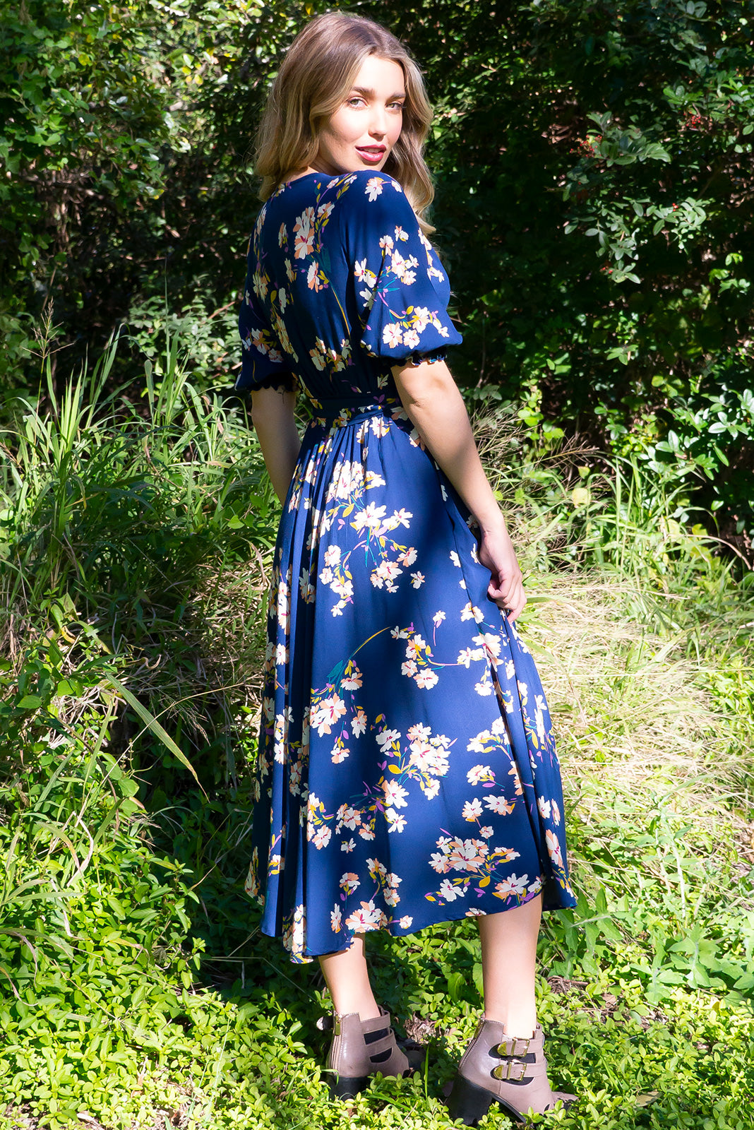 Primrose Oceans Navy Dress is made from 100% Rayon. Functional button down front in a vintage patterned fabric. Gorgeous deep navy. Comes with deep pockets. Flattering flowy skirt, very soft and comfortable. Retro Inspired.