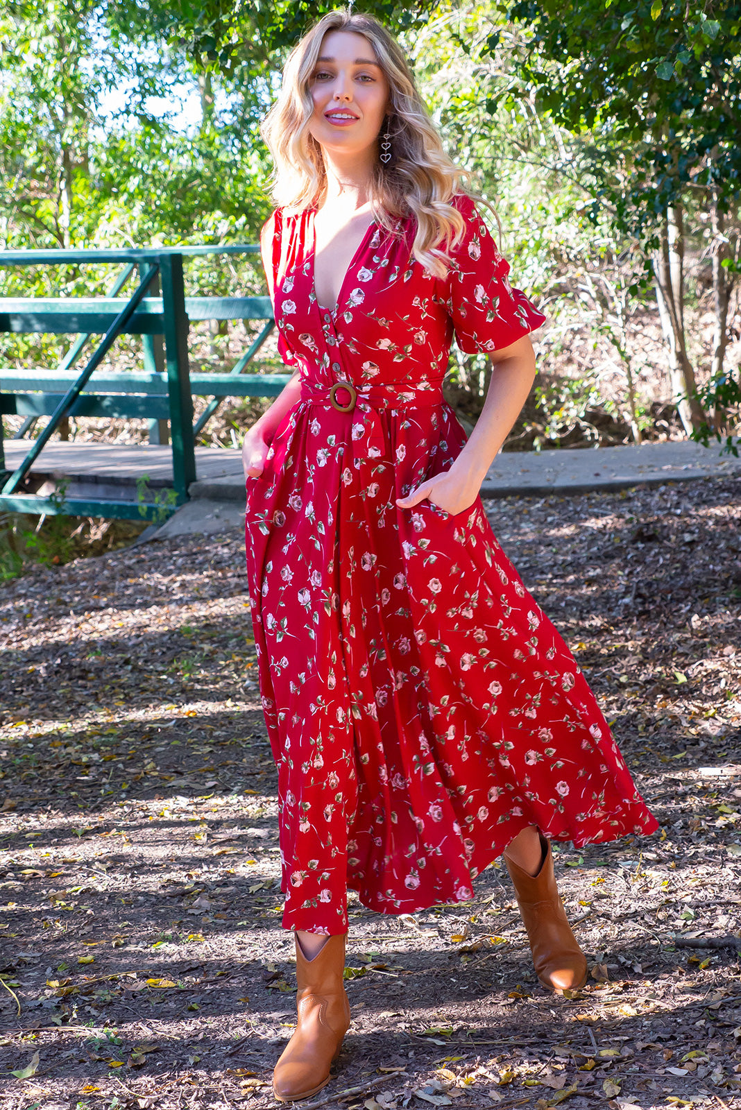 Primrose Red Rosedrop Dress is made from 100% Rayon. Functional button down front in a vintage patterned fabric. Gorgeous deep red romantic shade. Comes with deep pockets. Flattering flowy skirt, very soft and comfortable. Retro Inspired.