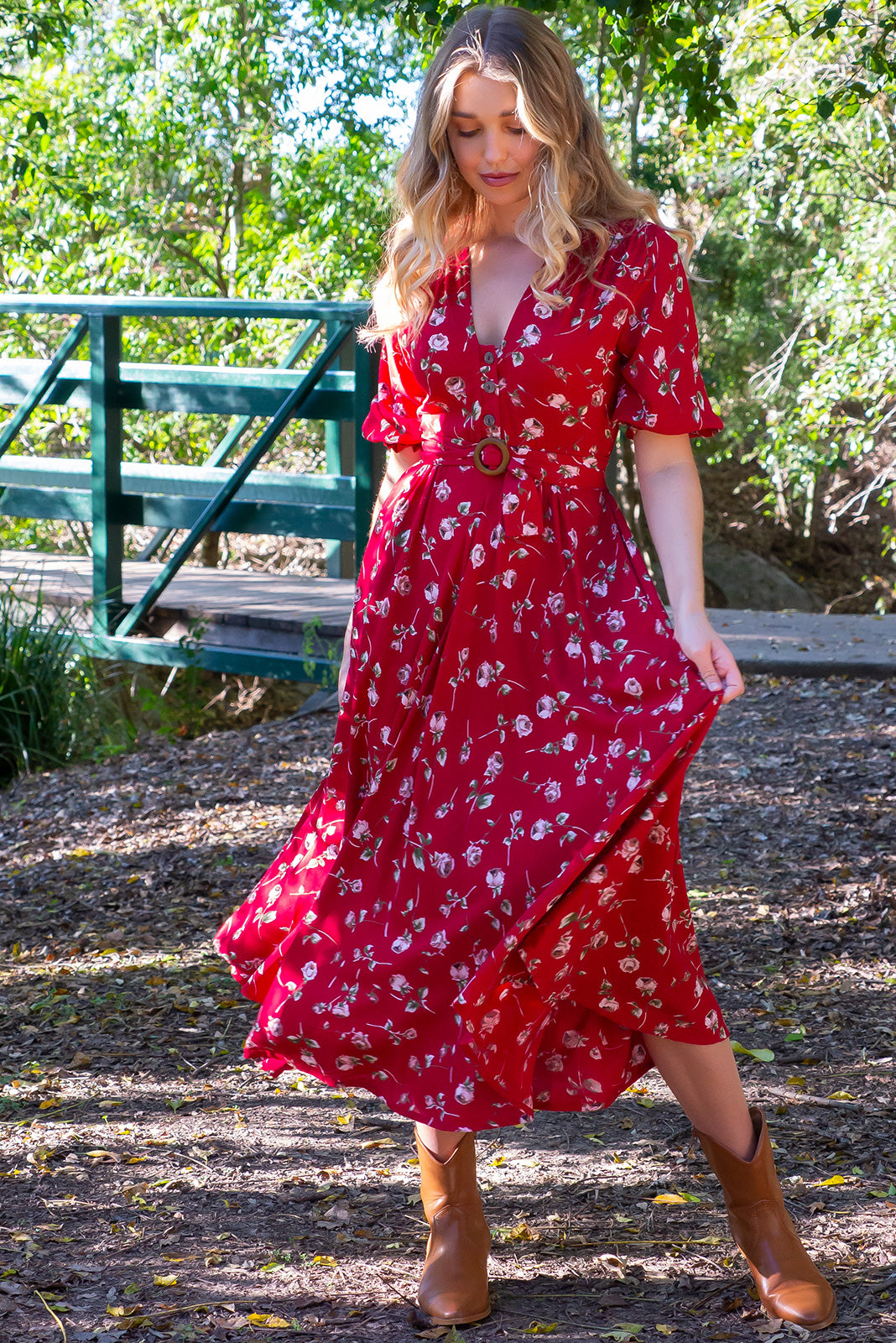Primrose Red Rosedrop Dress is made from 100% Rayon. Functional button down front in a vintage patterned fabric. Gorgeous deep red romantic shade. Comes with deep pockets. Flattering flowy skirt, very soft and comfortable. Belt included, Retro Inspired.