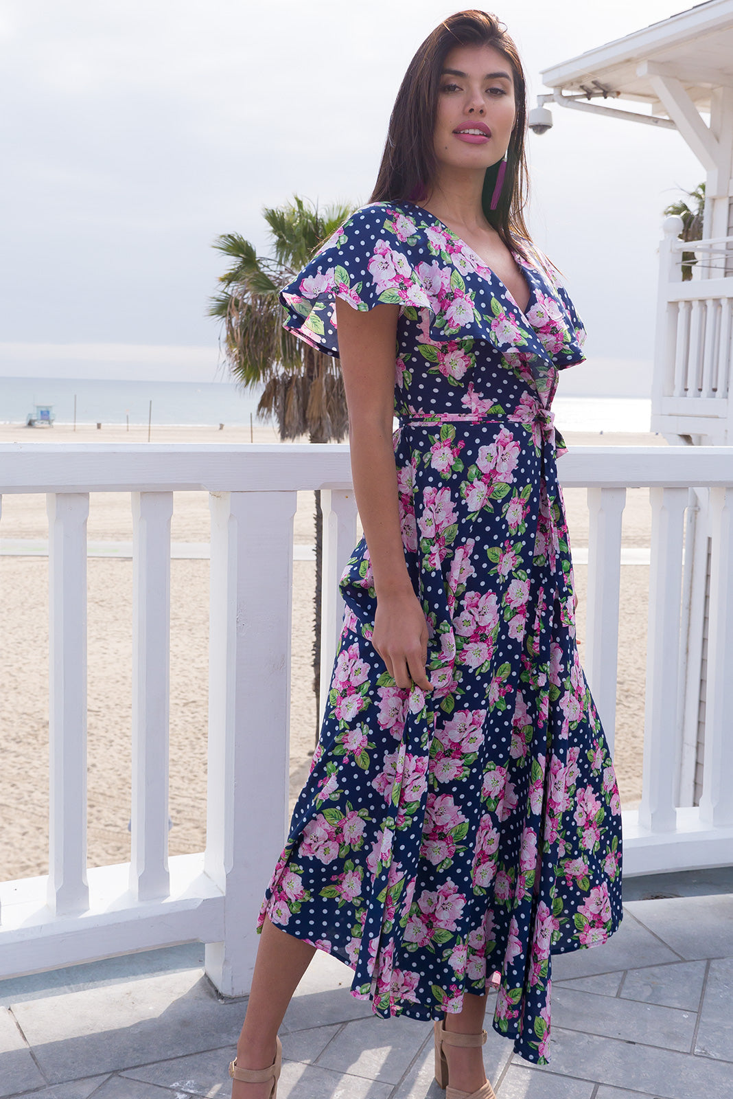 Rita Rio Sweet Spot Maxi Wrap Dress with a full frill around the neck and sleeve in soft navy and white spot with a floral print on woven rayon