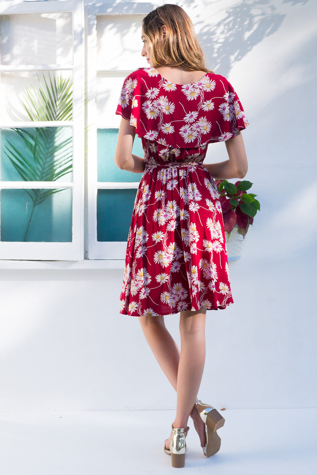 Rita Rio Red Daisy Wrap Dress with a full frill around the neck and sleeve in a bright red daisy print on rayon