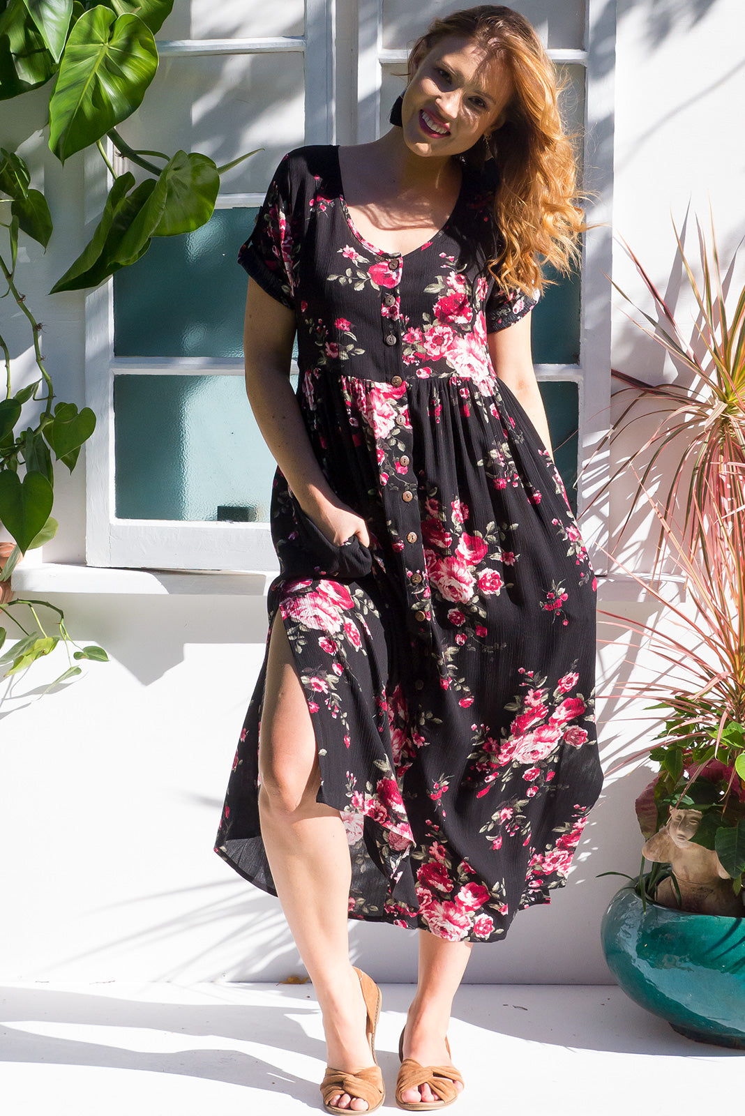 Rocco Bahati Black button front maxi dress in true black with a romantic roses print on soft crinkled rayon