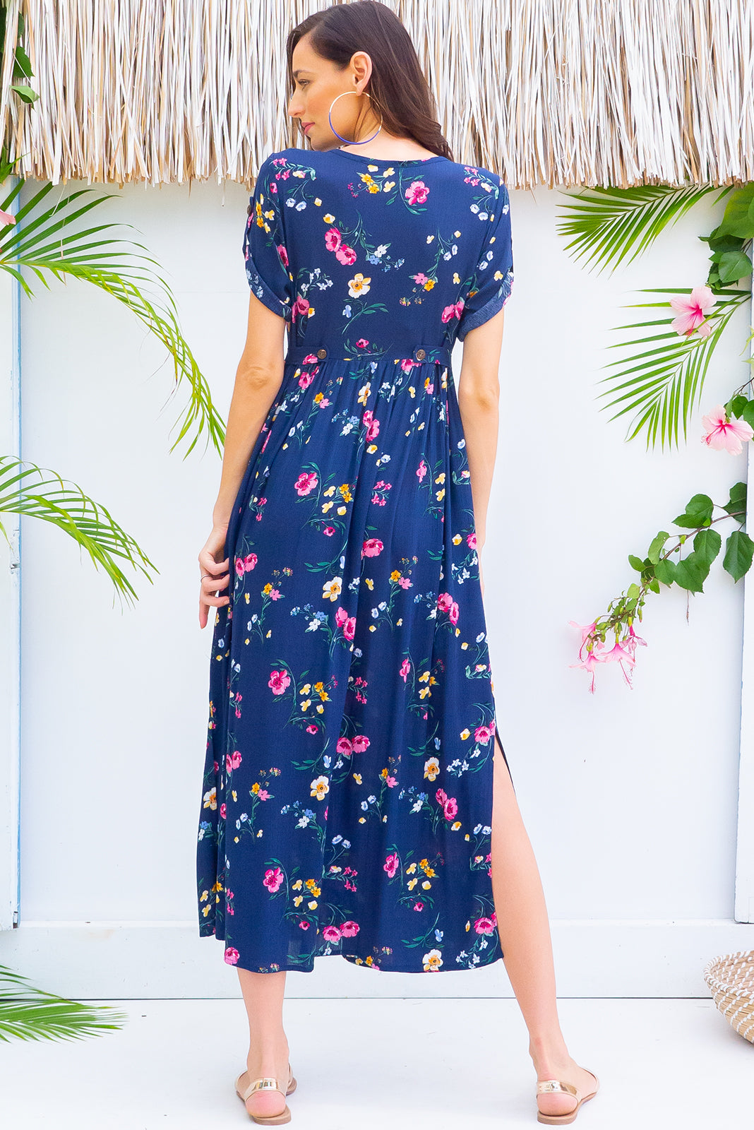 Rocco Chelsea Navy button front maxi dress with roll up tab sleeves, deep side pockets, adjustable tab waist and a soft loose fit comes in a bright navy and multicoloured floral print on crinkle textured 100% rayon