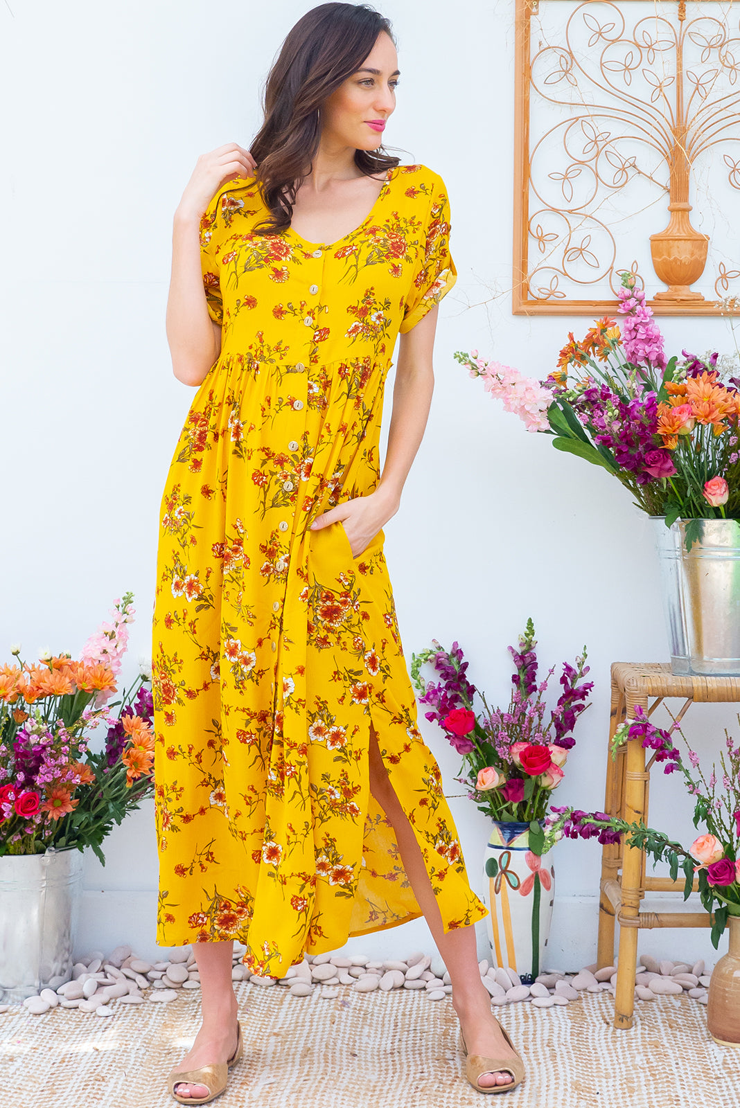 Rocco Golden Sunsets button front maxi dress with roll up tab sleeves, deep side pockets, adjustable tab waist and a soft loose fit comes in a deep golden yellow floral print on crinkle textured 100% rayon