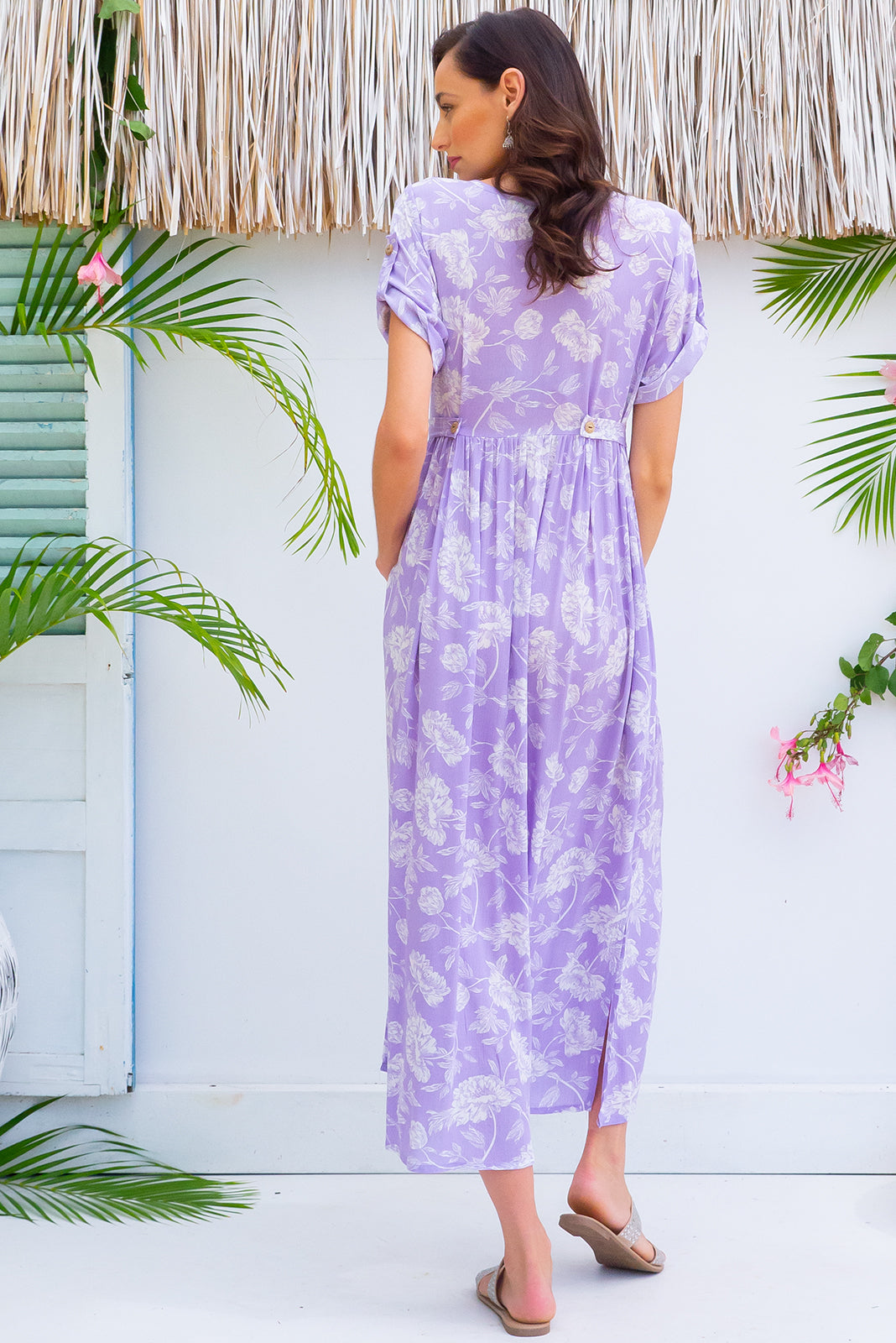 Rocco Lavender Love button front maxi dress with roll up tab sleeves, deep side pockets, adjustable tab waist and a soft loose fit comes in a bright lavender and white floral print on crinkle textured 100% rayon