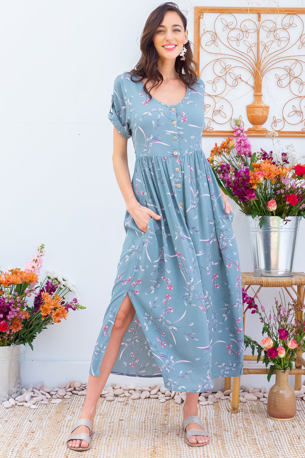 Rocco Rustic Sprig button front maxi dress with roll up tab sleeves, deep side pockets, adjustable tab waist and a soft loose fit comes in a dusty sage green floral print on crinkle textured 100% rayon